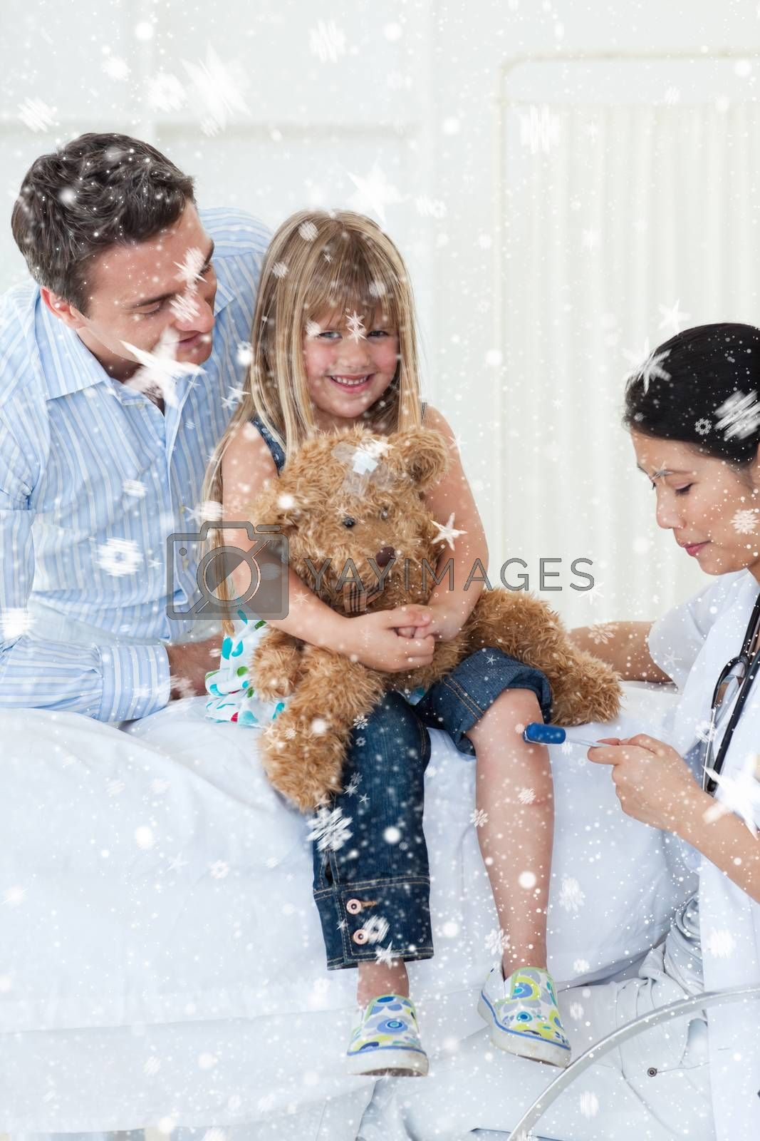 Composite image of Female doctor checking patients reflex with snow falling