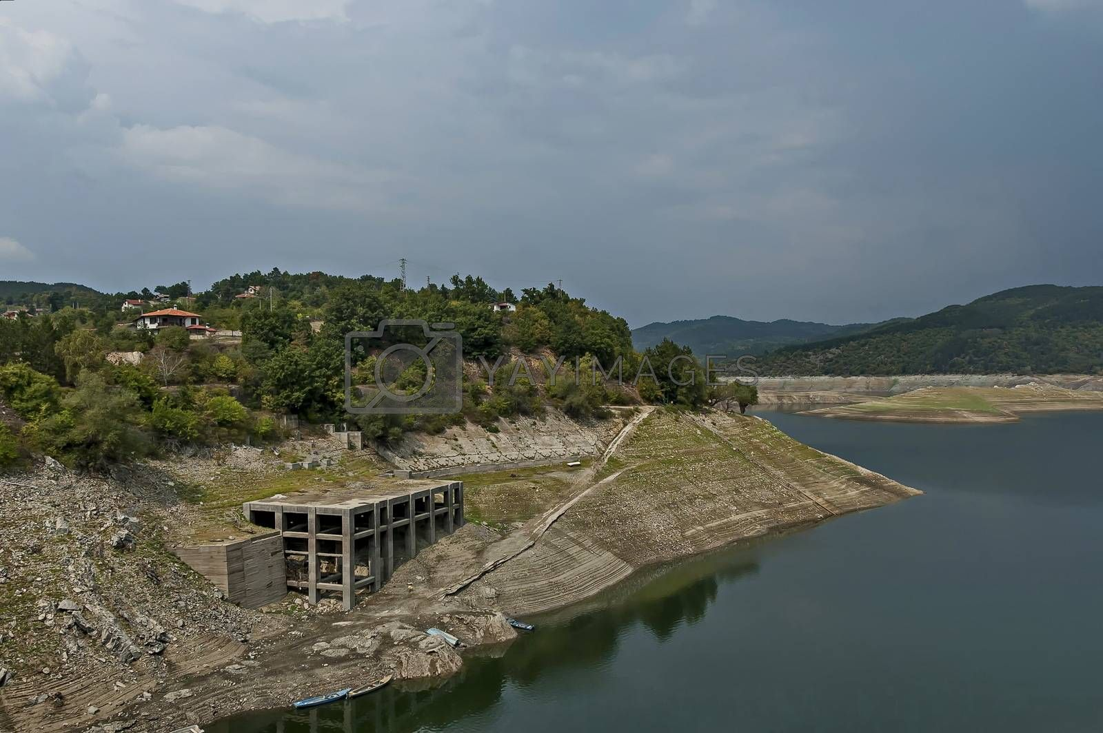 View from Topolnitsa dam, lake or barrage on the river Topolnitsa and part from village Muhovo, Ihtiman region, Bulgaria, Europe