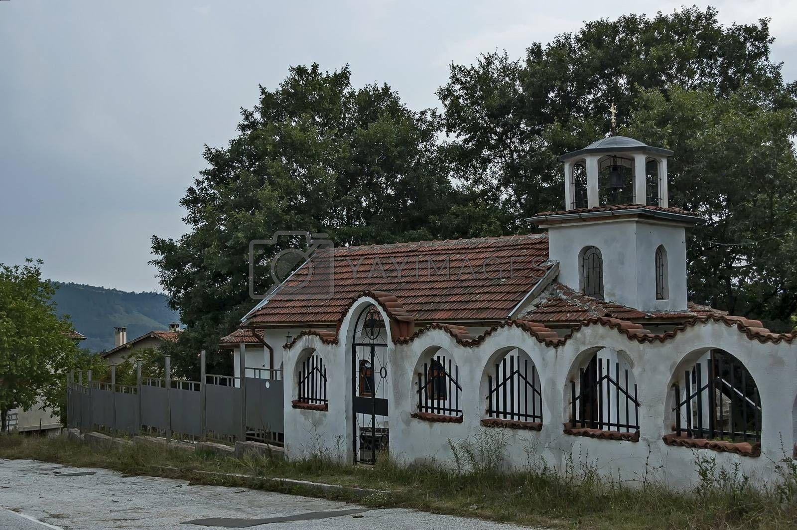 A beautiful landscape with a small old church in the village of Muhovo, Ihtiman region, Bulgaria, Europe