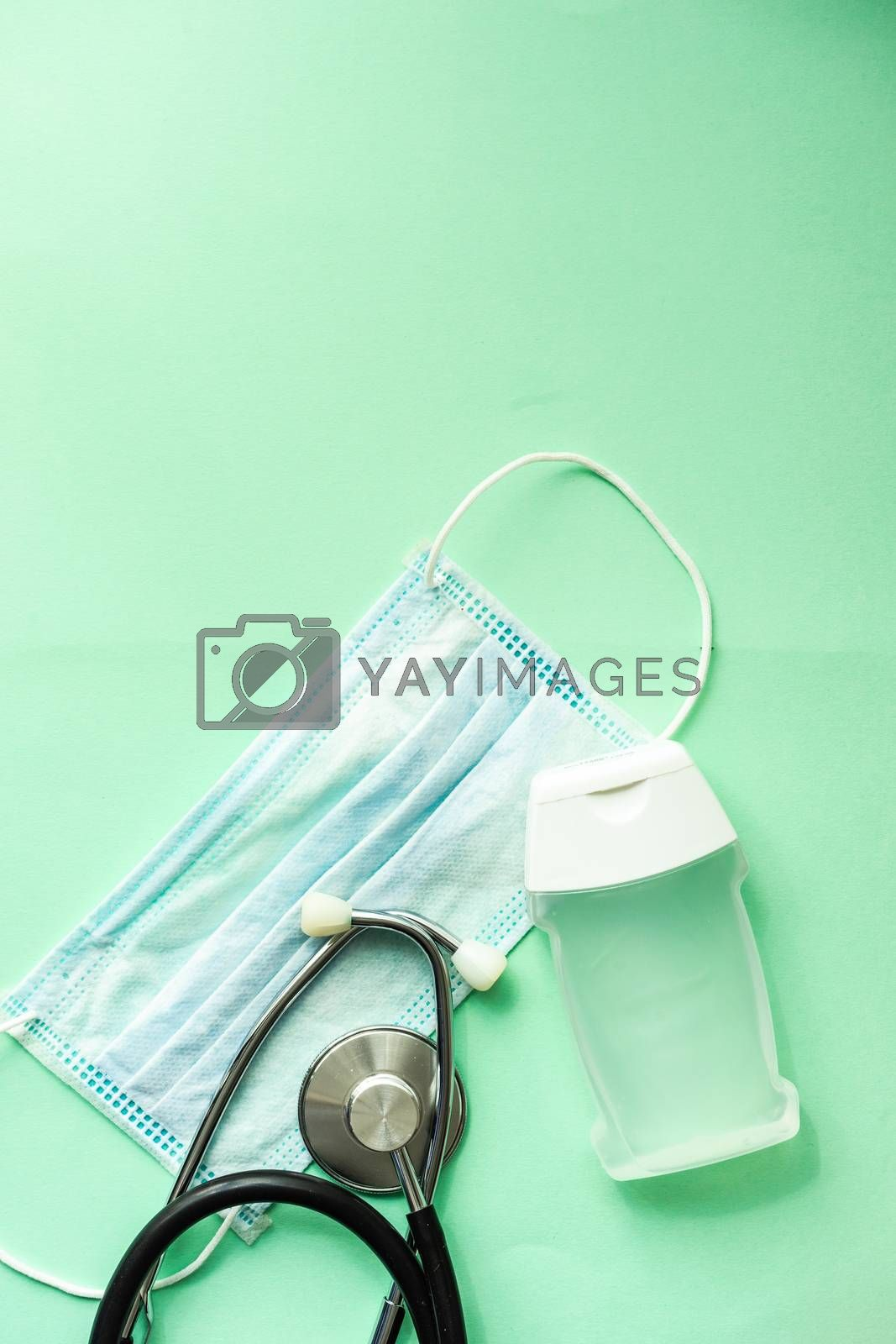 Coronavirus or Covid-19 epidemic healthcare concept on mint green pastel background with copy space