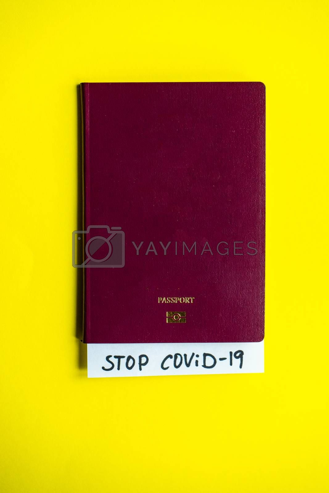 COVID-19 virus concept with passport and medicine staff onyellow pastel background with copy space