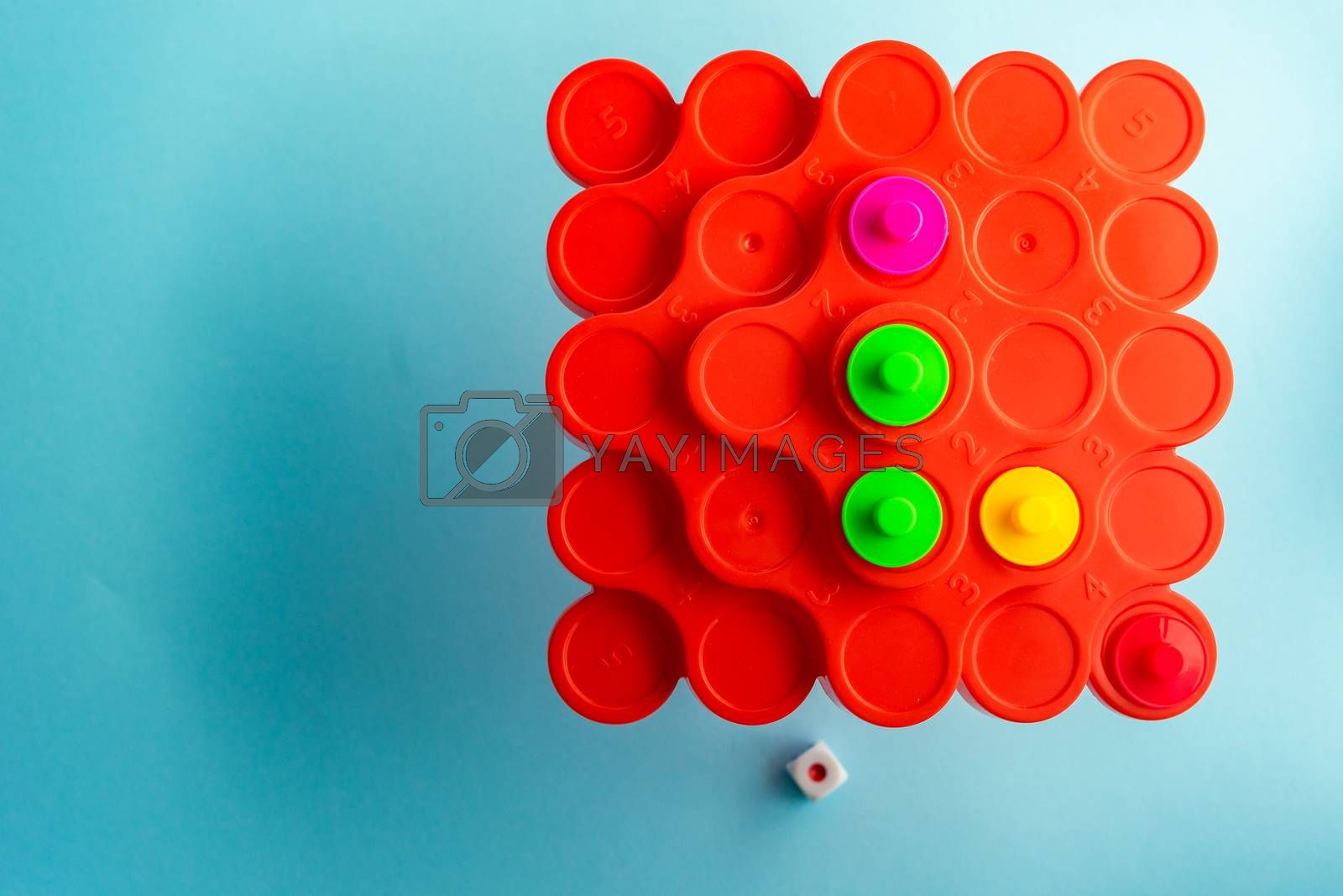 COVID-19 virus concept with board games on pastel background with copy space