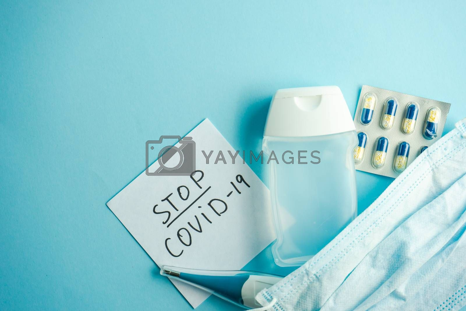 COVID-19 virus concept with health care staff on pastel blue background with copy space
