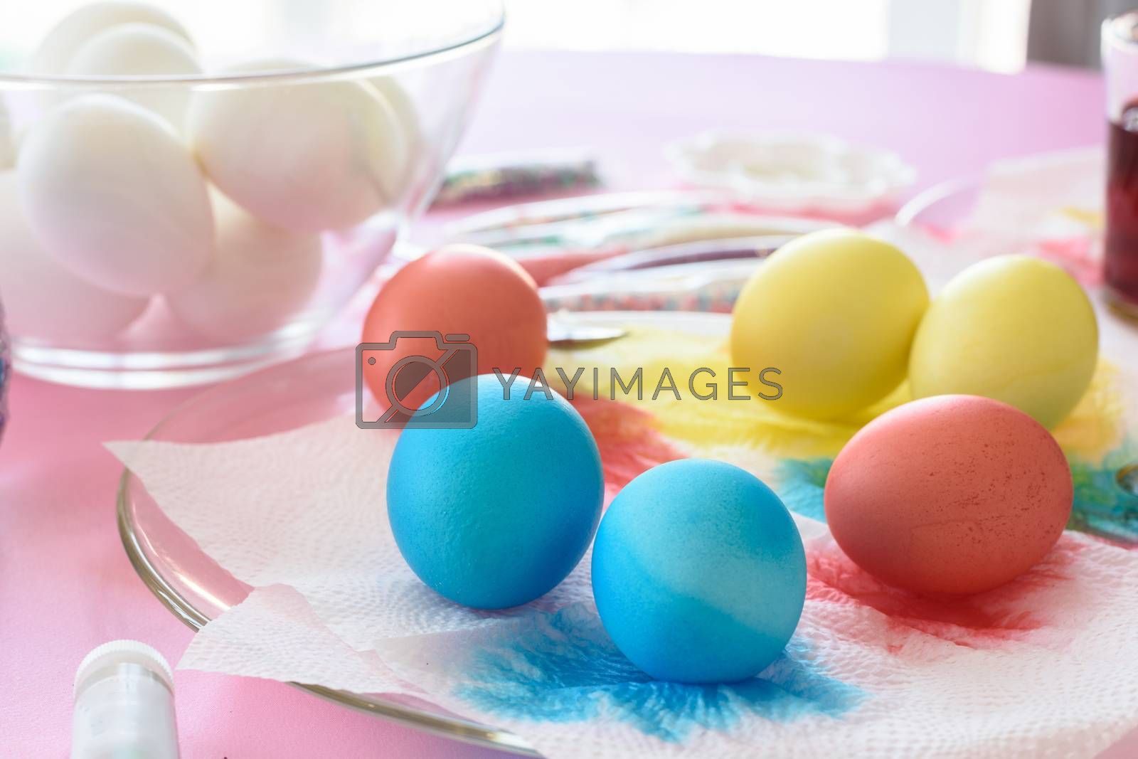 Painting in different colors of eggs for Easter