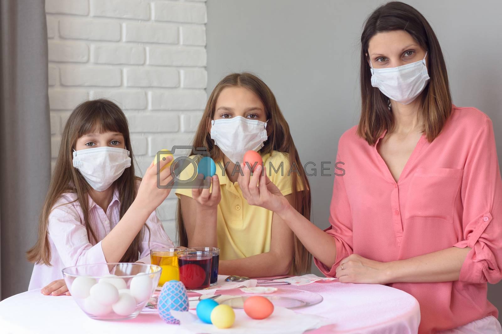 quarantined family paints eggs for easter