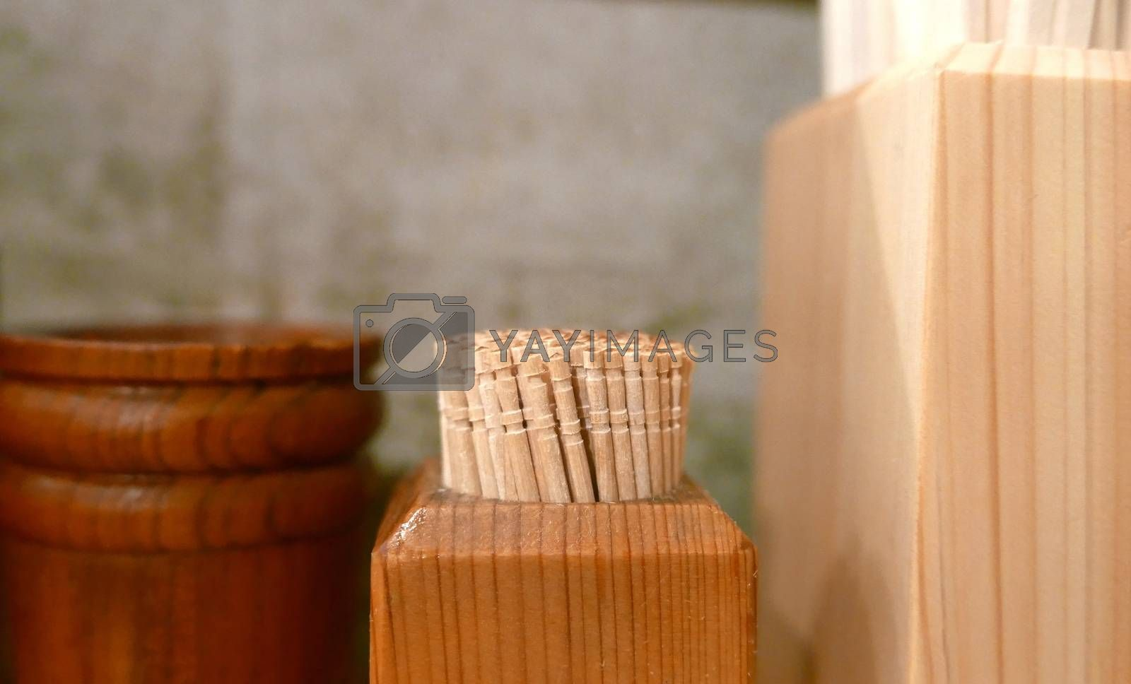 The box of toothpicks and chopsticks