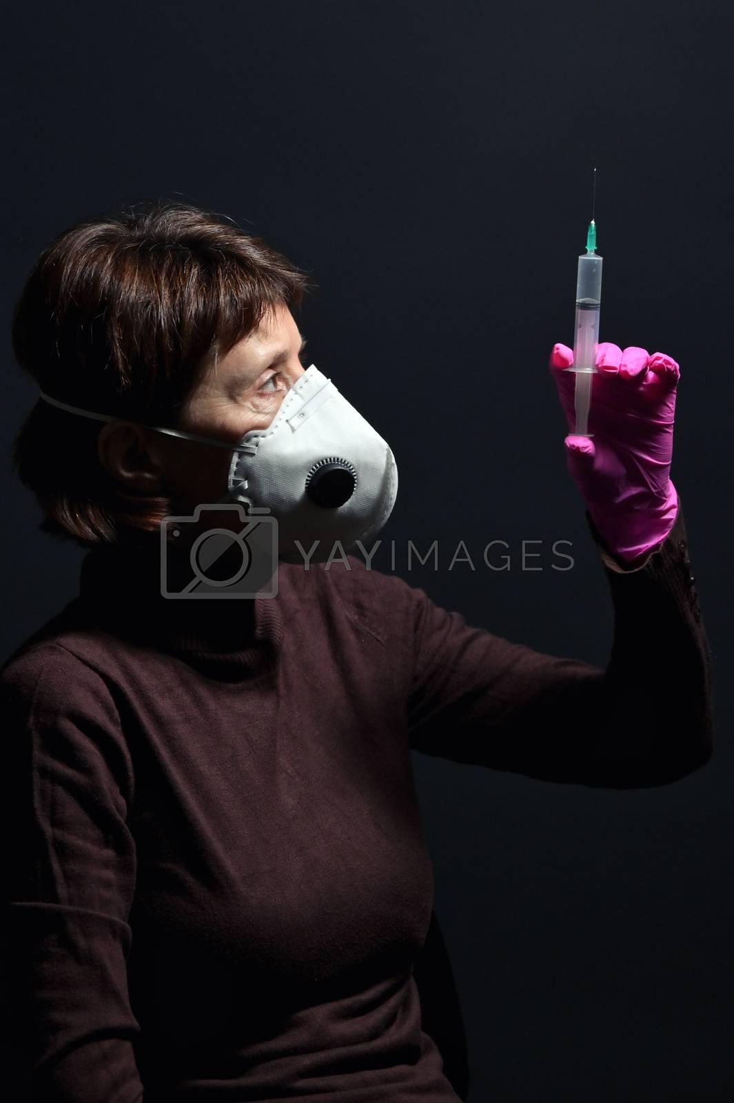 Woman Wearing Medical Protective Virus Mask and Syringe