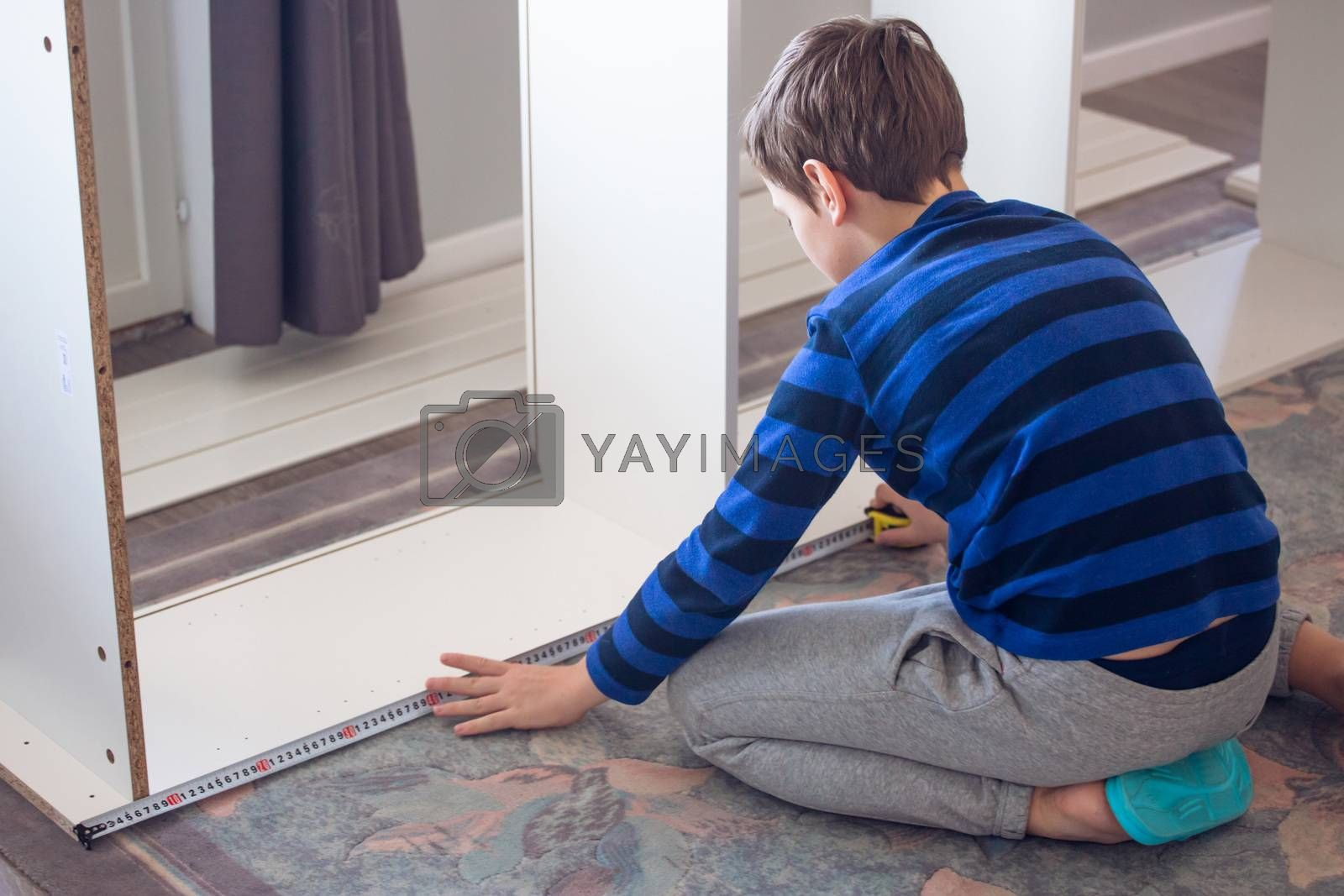 Hobby, carpentry, woodwork, craft, skill concept - boy making constructing assembling furniture at home