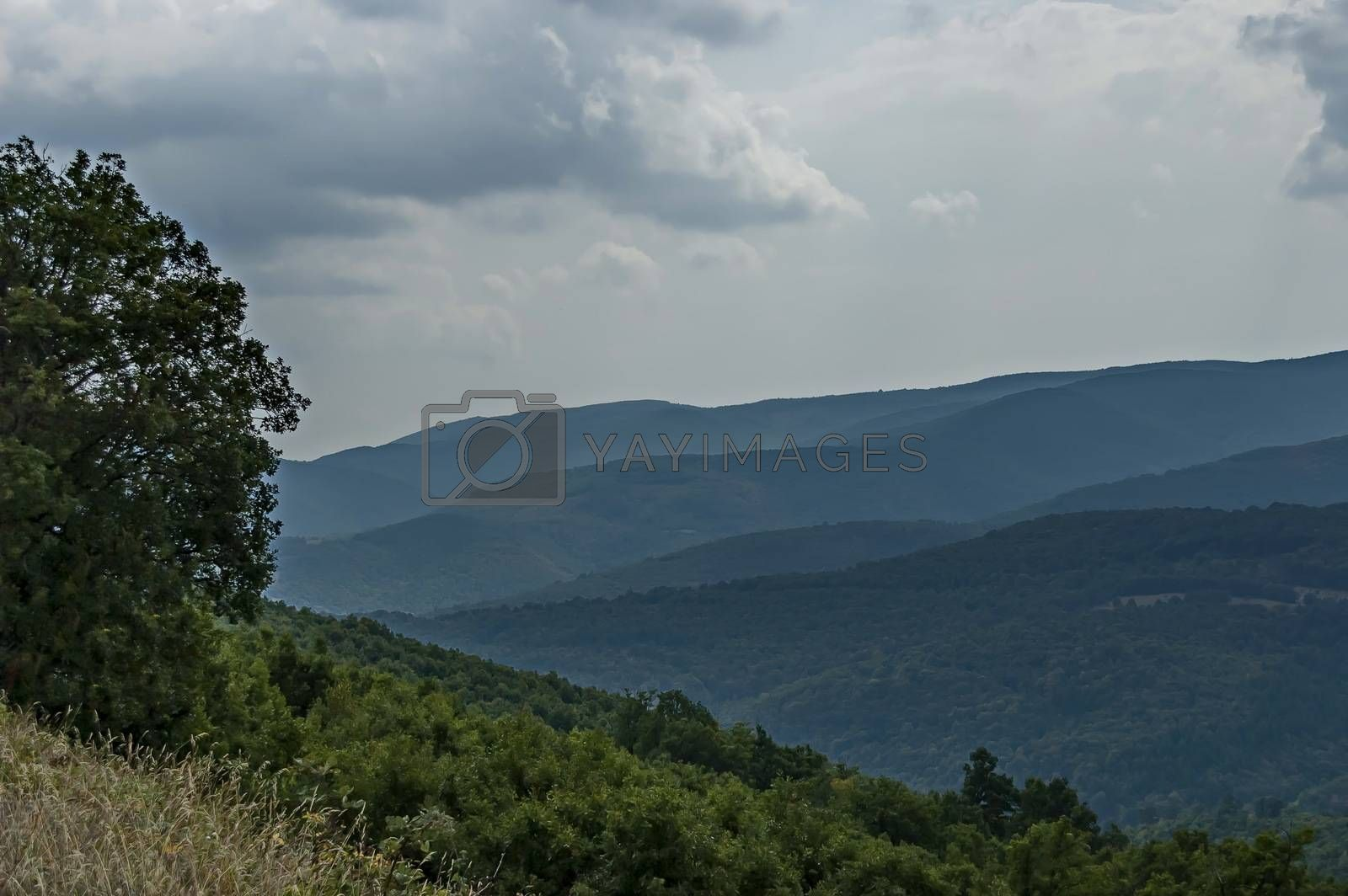Amazing autumn view of glade, peak and forest with deciduous trees  in Sredna gora mountain, Bulgaria