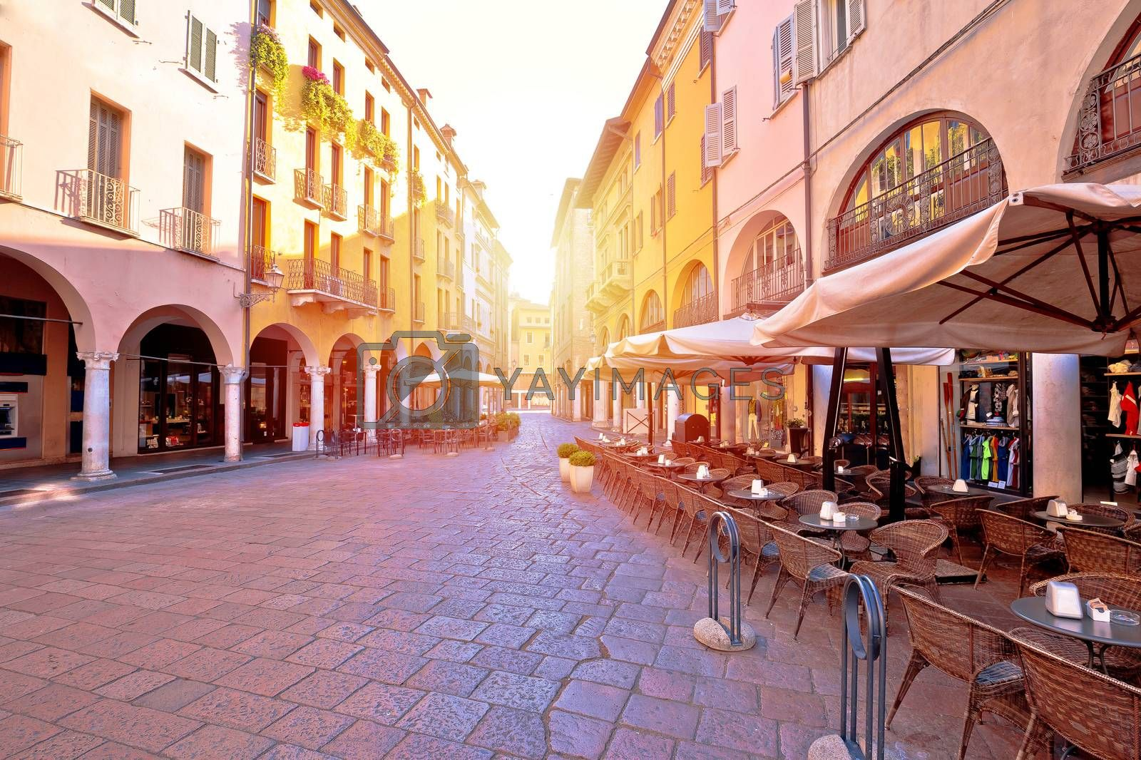 Mantova city street sun haze view, UNESCO world heritage site, Lombardy region of Italy