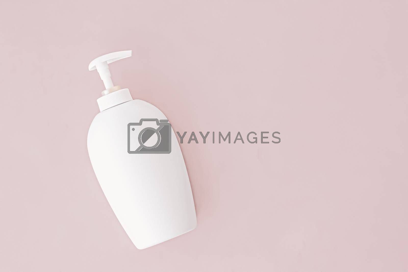 Bottle of antibacterial liquid soap and hand sanitizer on beige background, hygiene product and health care concept