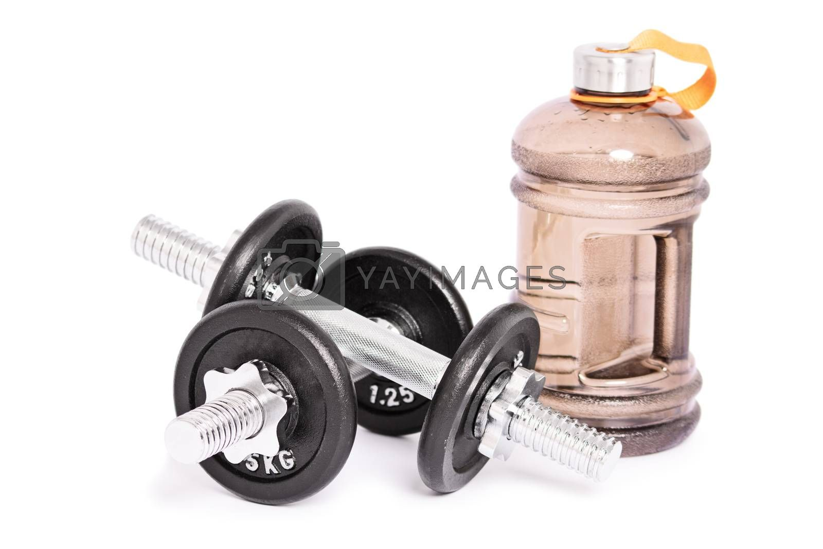 Close up shot of two stainless steel dumbbells and a large water bottle for the gym, isolated on a white background. Healthy lifestyle and fitness concept. Copy space.