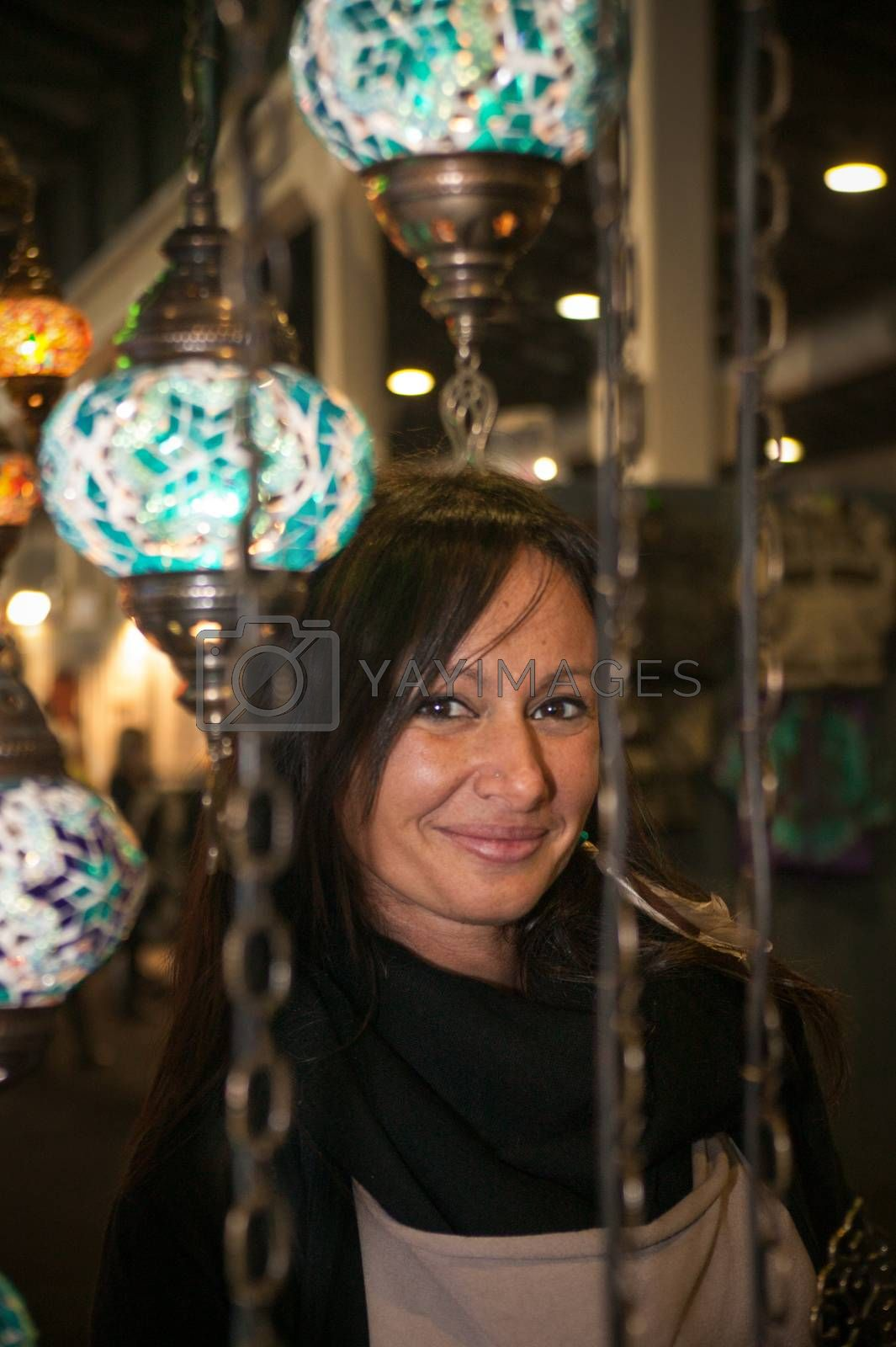 Brunette girl close up between lit oriental lamps