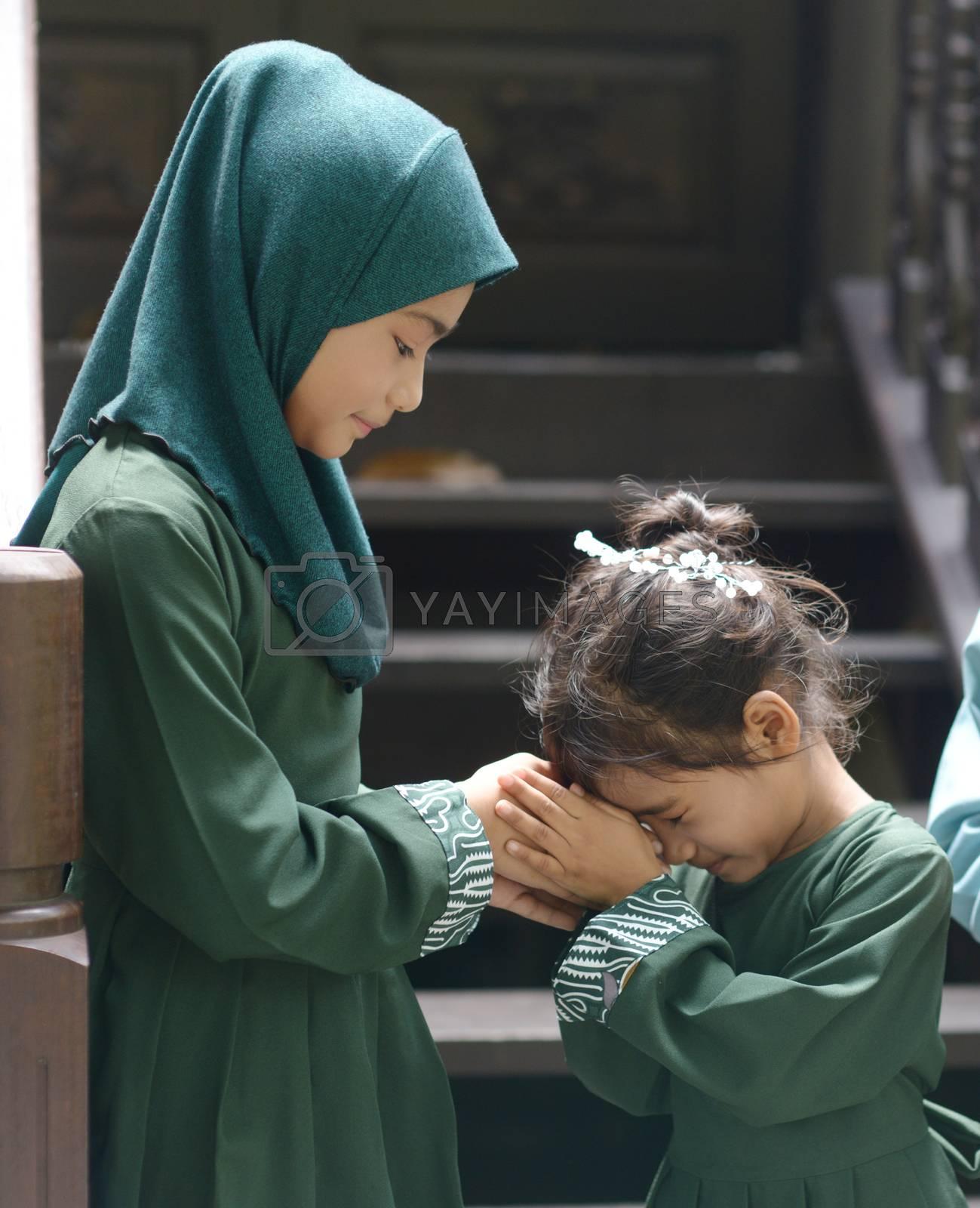 Muslim children greeting, Hari Raya Eid Al-Fitr concept.