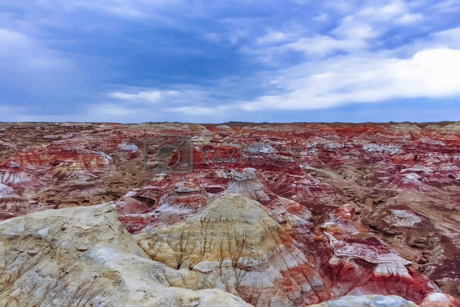 Colored rock formation against blue sky at Wucaitan (Five Colored Hills aka Rainbow Beach) in Burqin County, Xinjiang, China