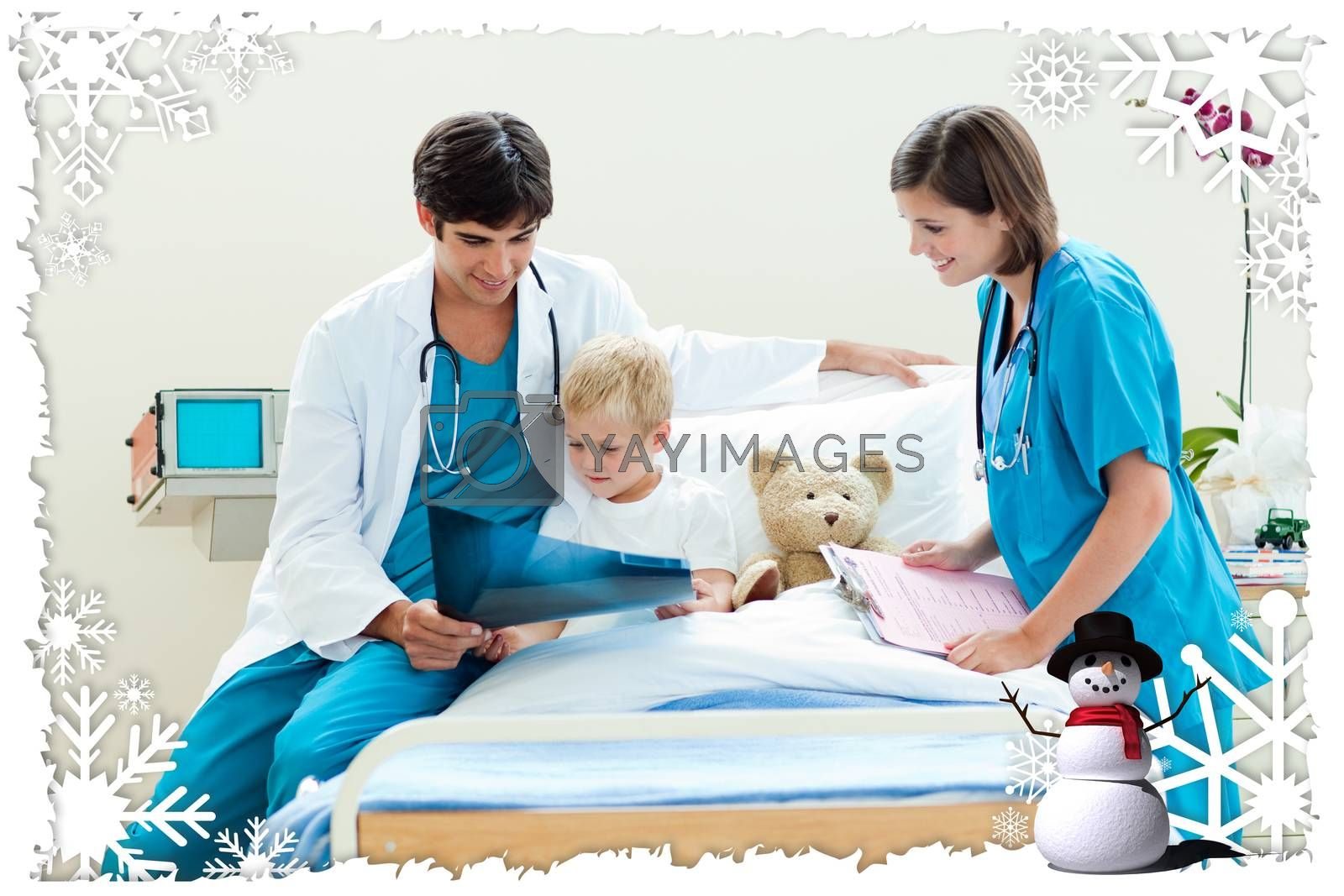 Attractive doctor showing an xray to his patient against christmas themed frame