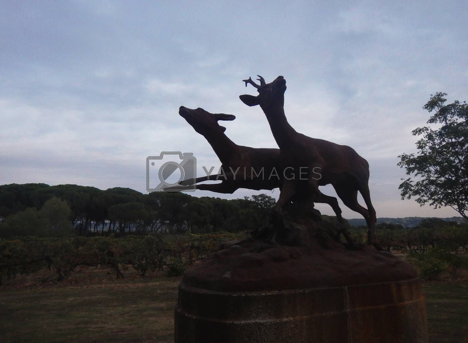 Sculpture dedicated to deer and hunting activity in nature