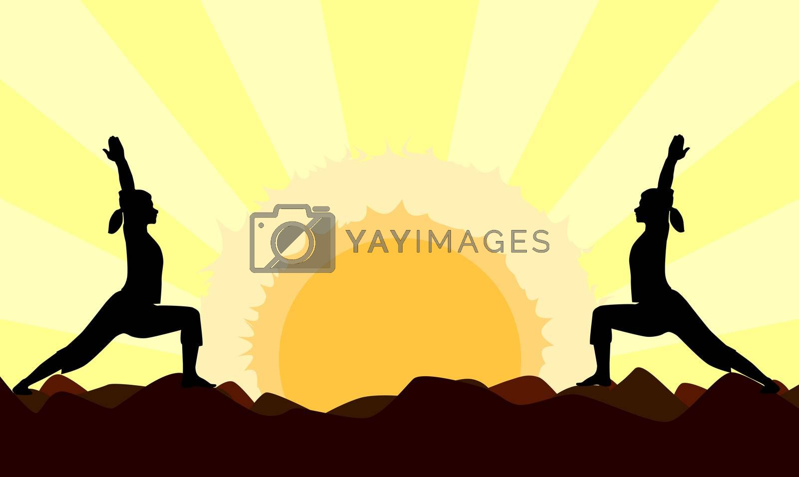 Two women performing a yoga asana against a powerful sunset.