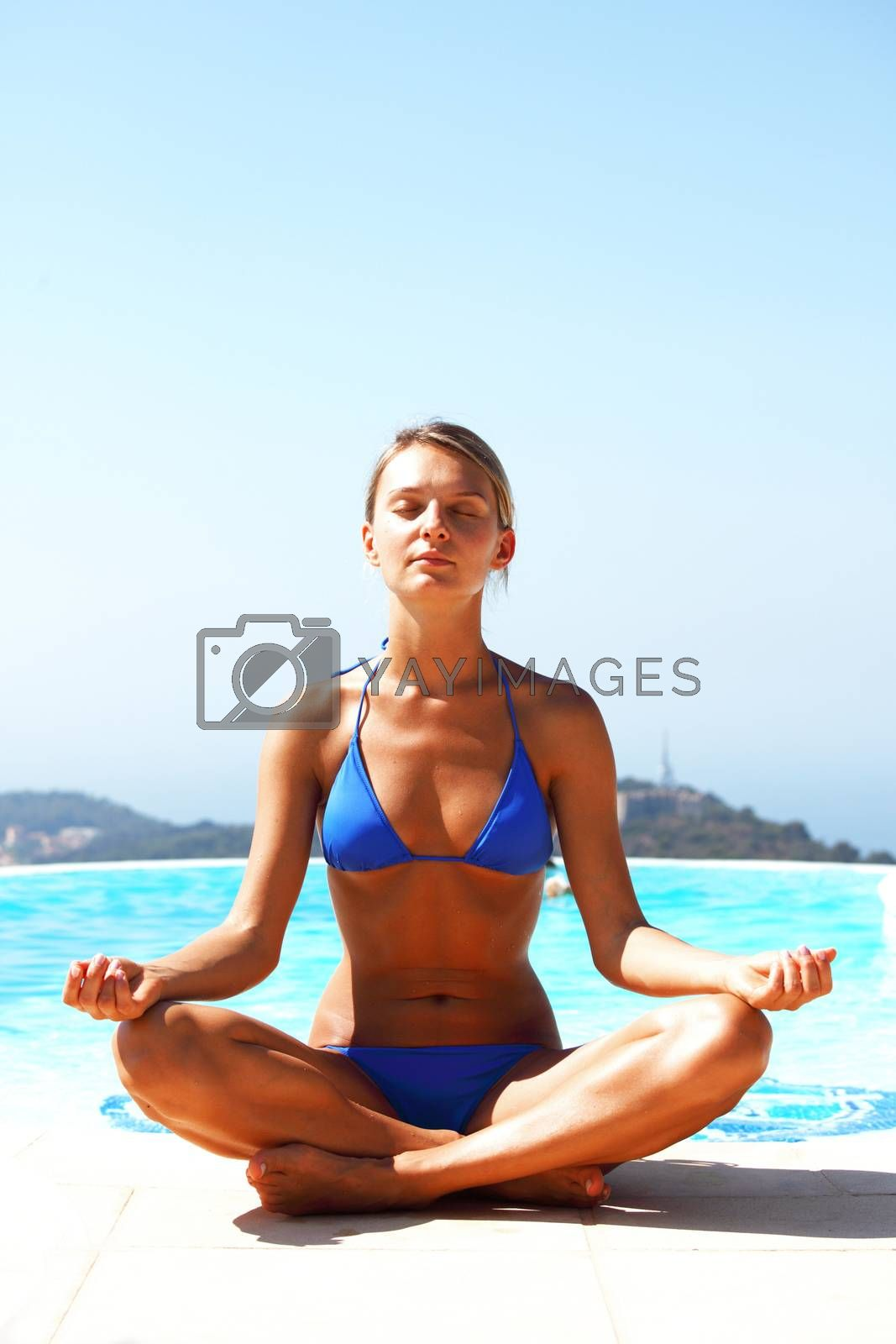 Woman doing yoga exercise by Yellowj