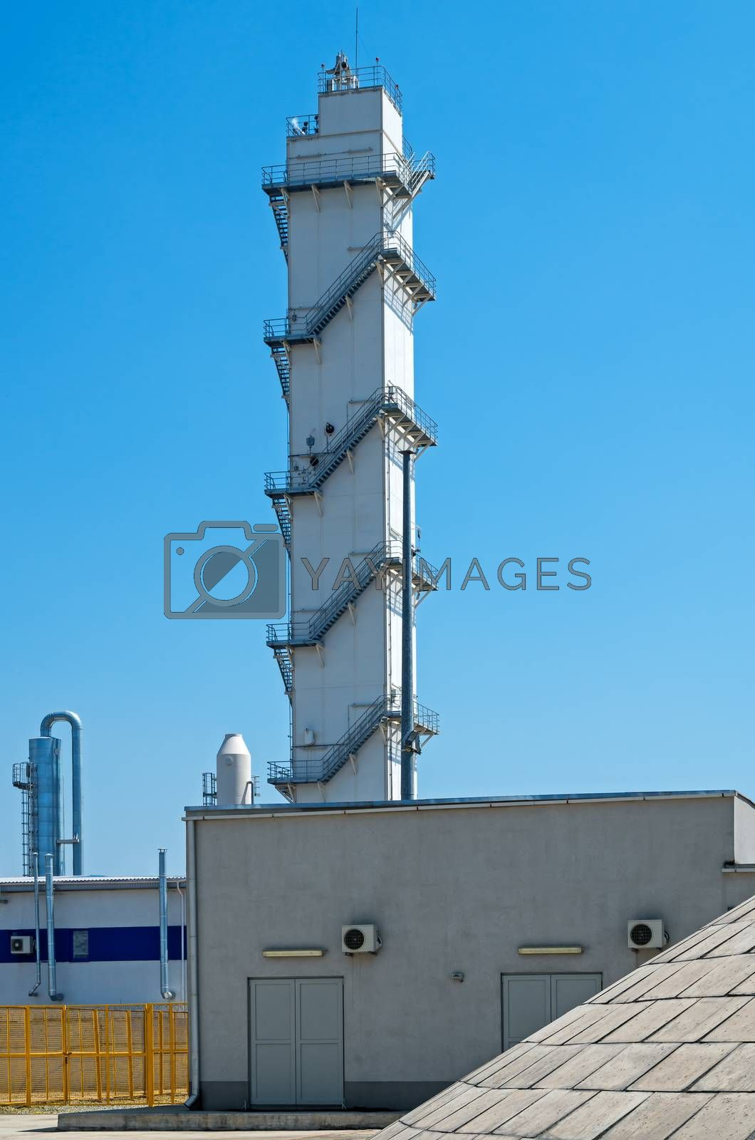 Manufacturing belfry electric steel plant on blue sky background.