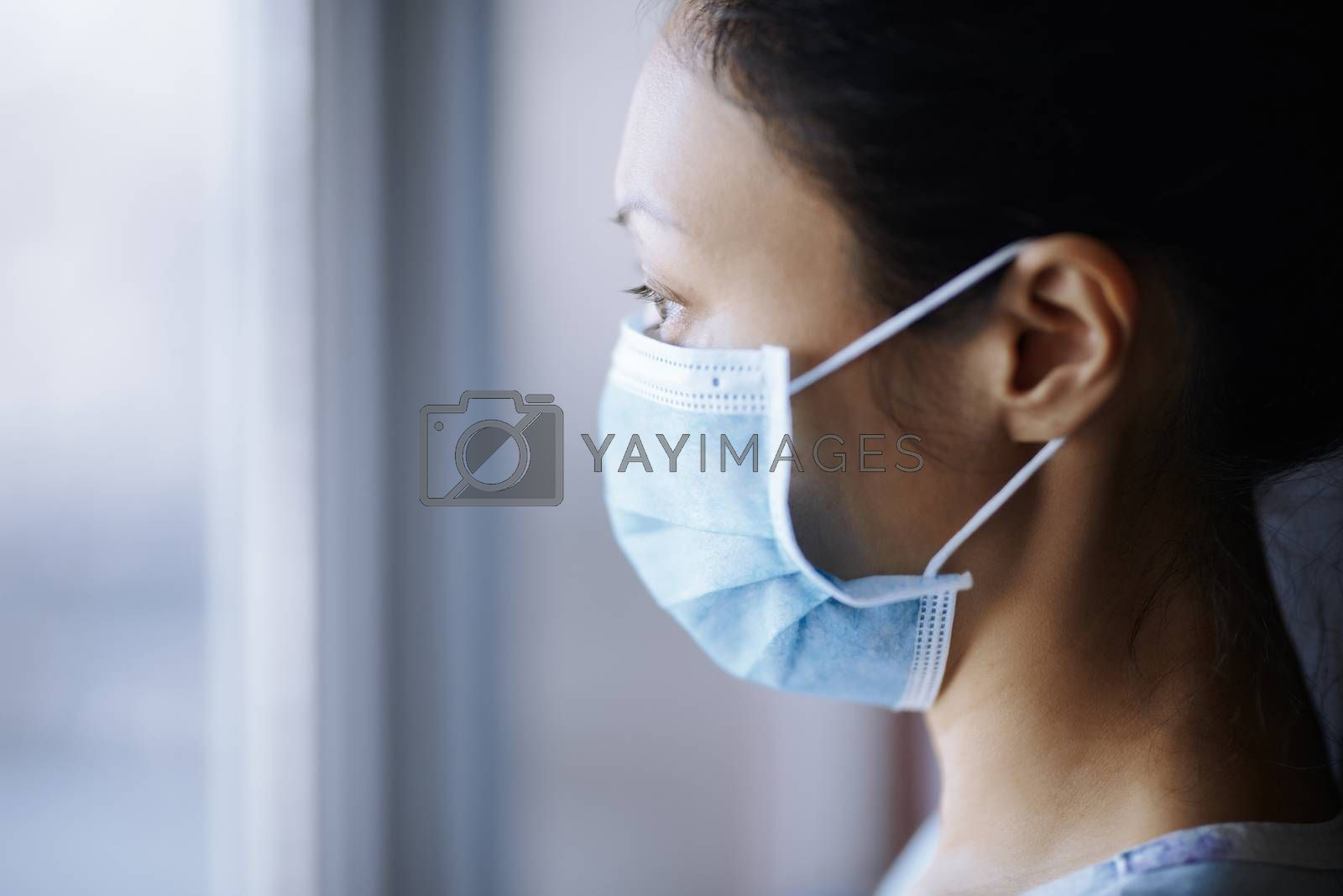 Woman staying at home and wearing protective surgical mask by Novic
