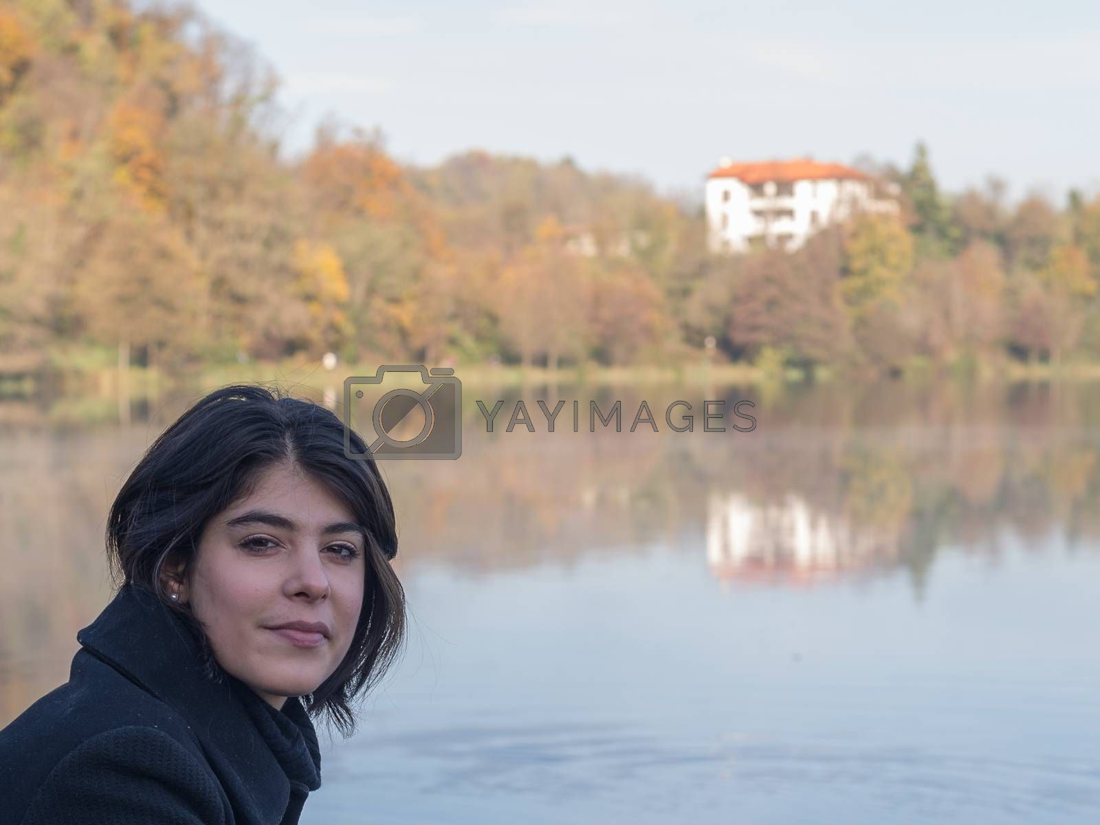 Royalty free image of girl with hair near the river bank by brambillasimone