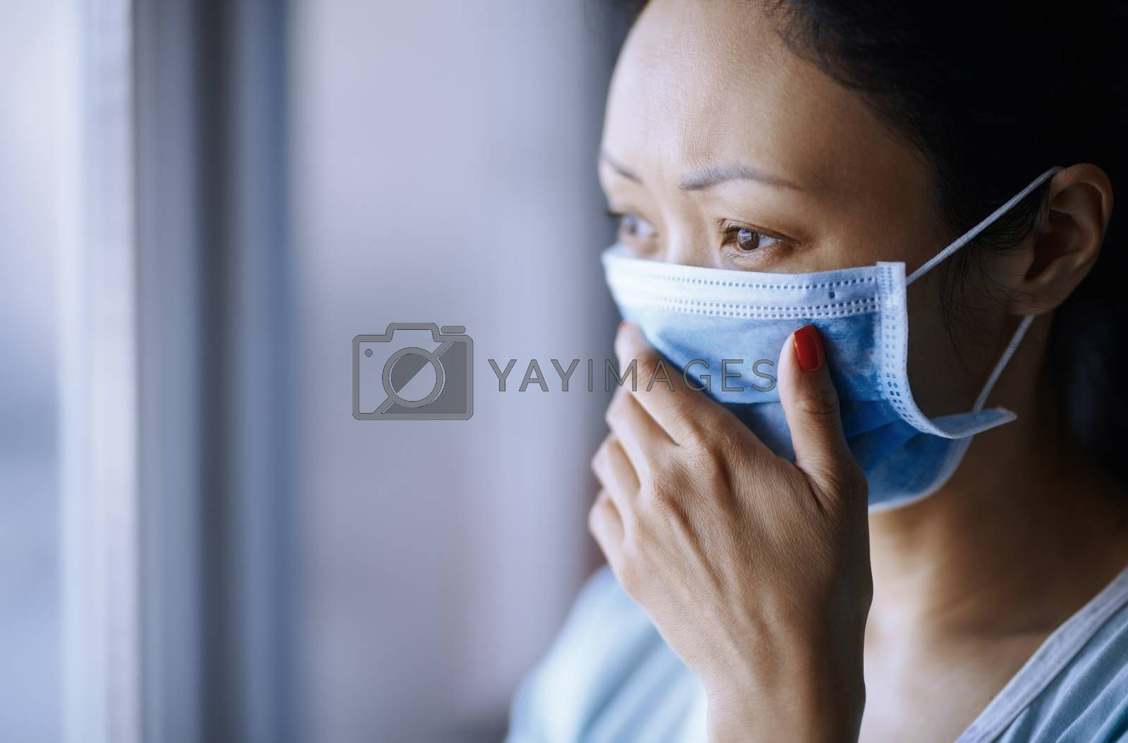 Woman staying at home wearing protective surgical mask by Novic