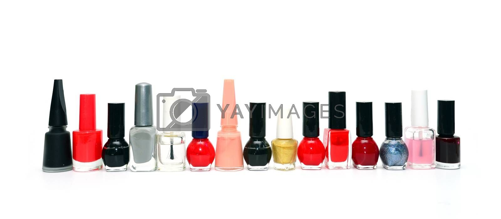 nail polish bottles in a row over white background