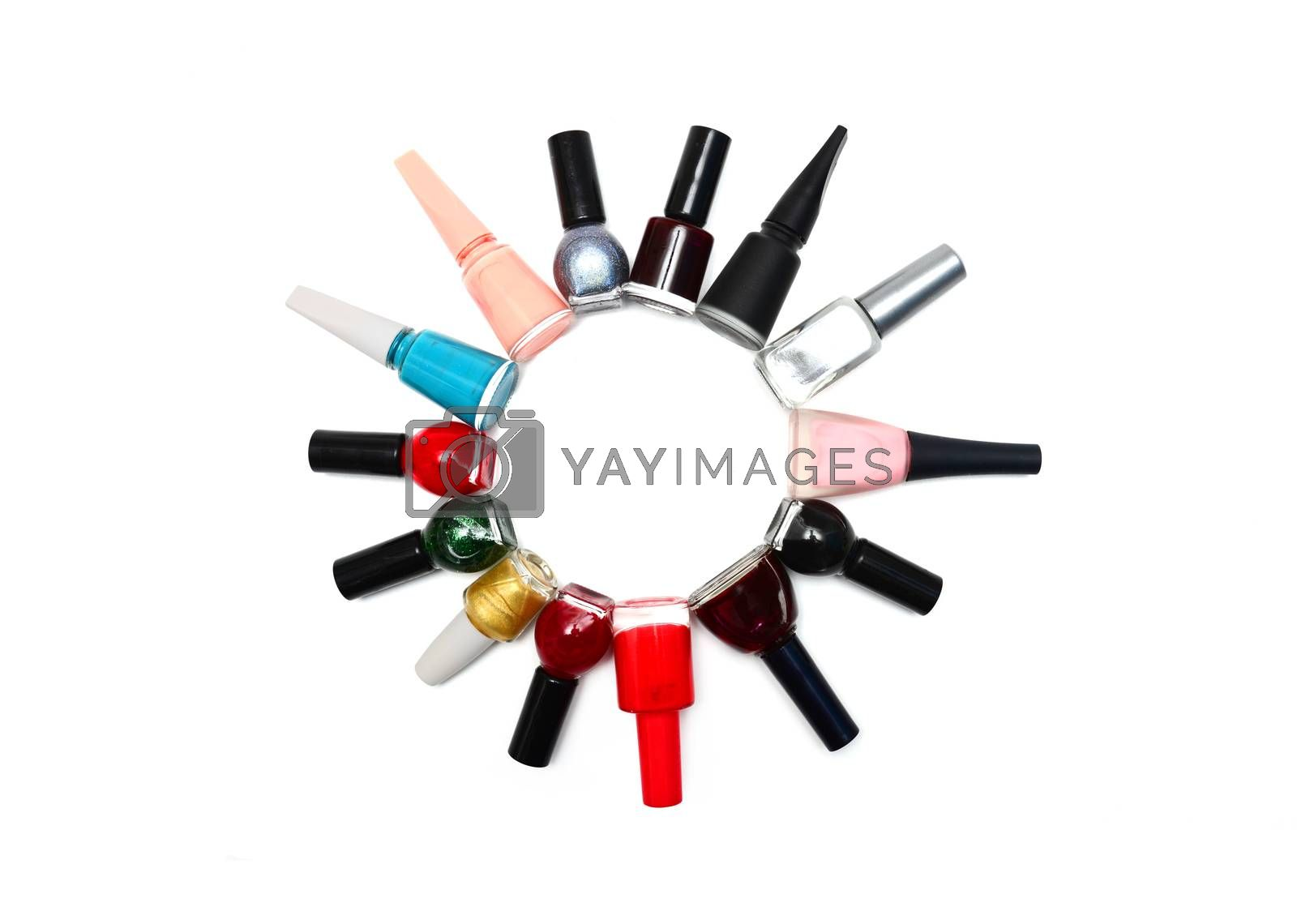 nail polish bottles in a circle over white
