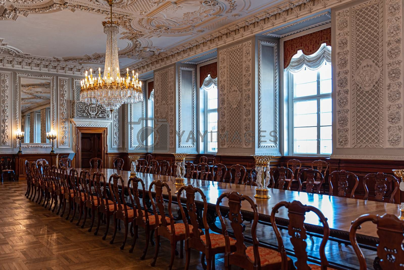 Interiors of the royal halls in the Christiansborg Palace in Copenhagen, Denmark, large antique table and crystal chandelier