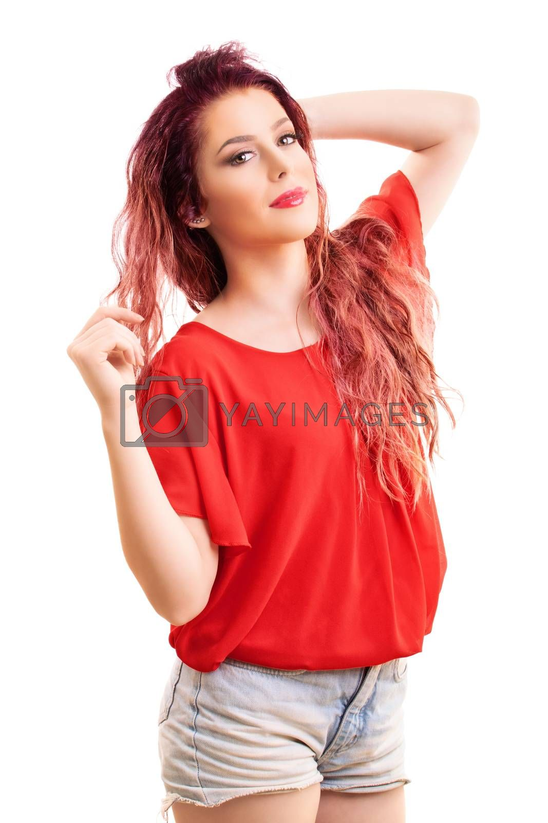 Beauty portrait of a beautiful young redhead girl playing with her hair, isolated on white background.