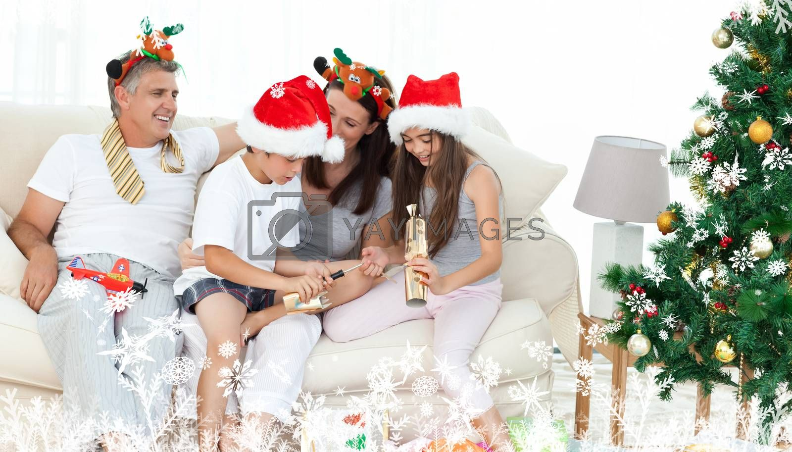 Composite image of a Family on Christmas day looking at their presents at home against frost