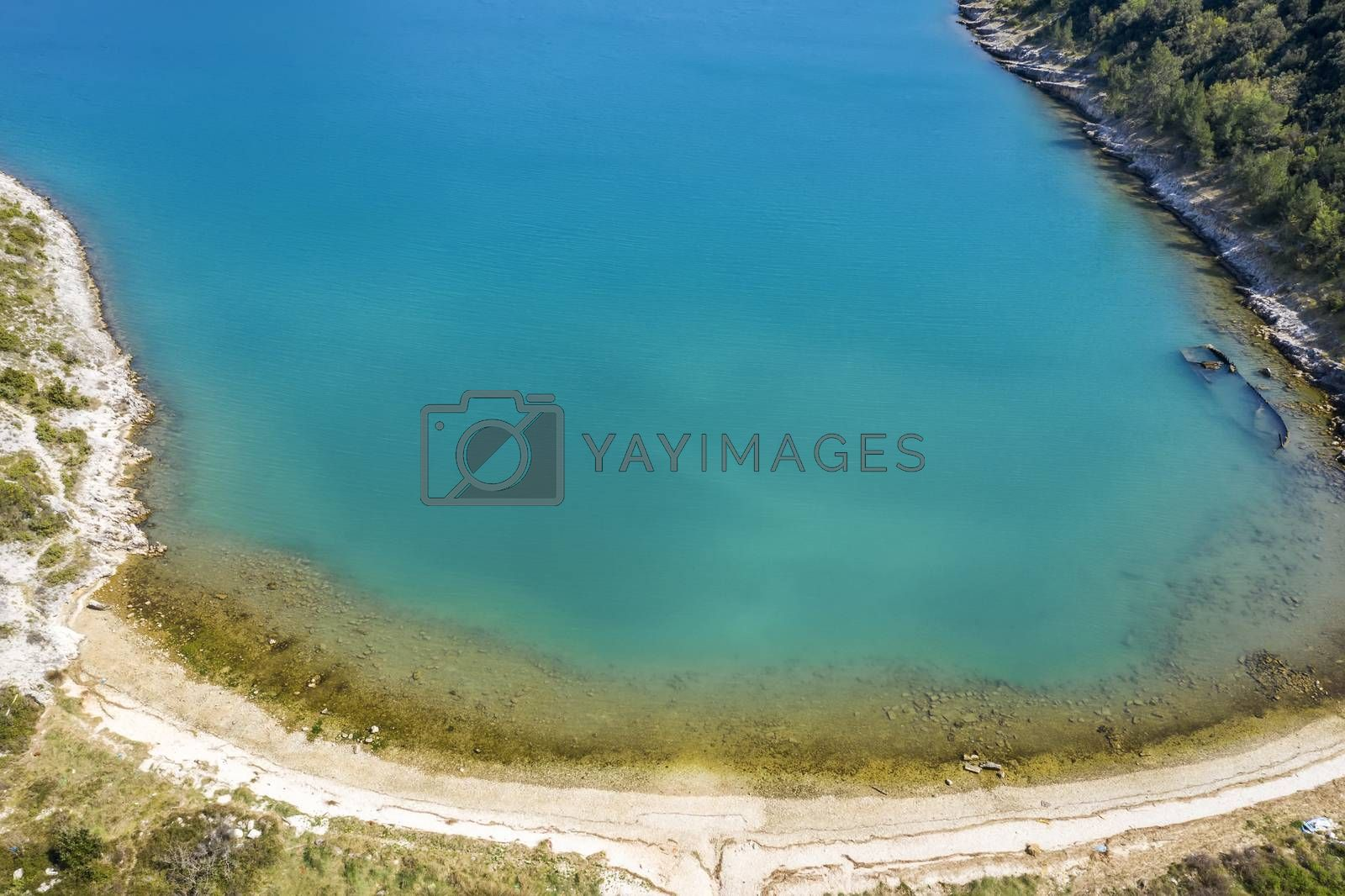 an aerial view of Salamustica in the Rasa bay, and the sinking German ship Fritz from World War II, in Istria, Croatia