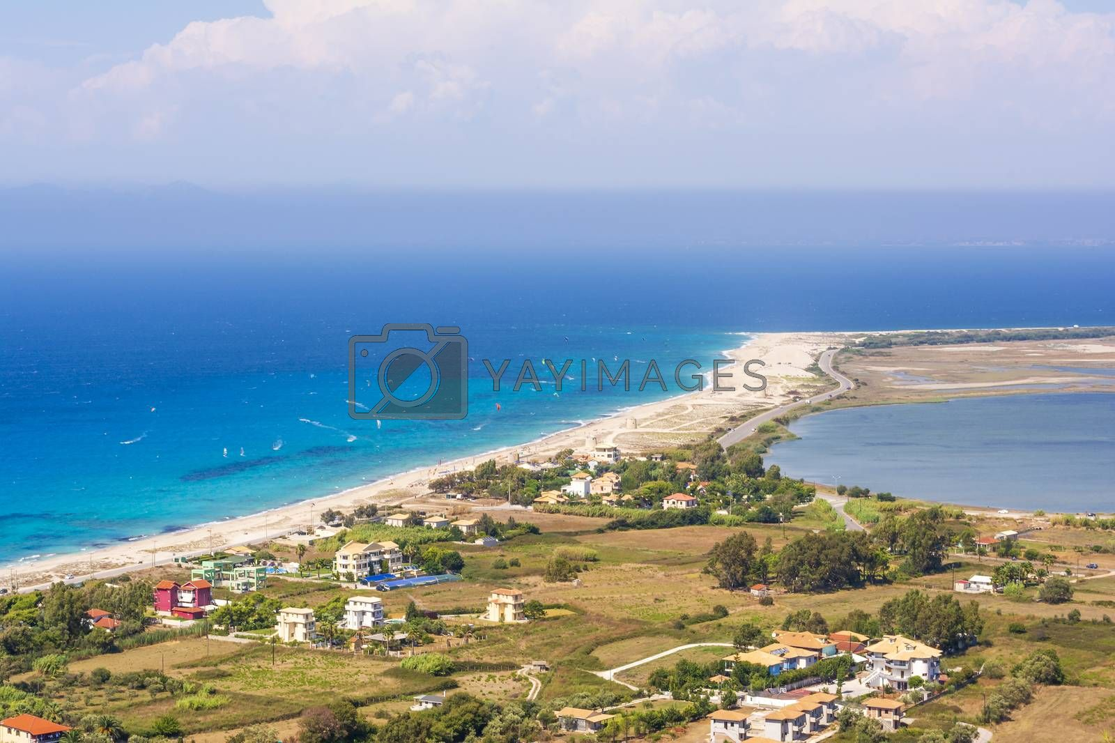 Ai Yiannis, Mili is a long sandy beach on the island of Lefkada, Greece. Preferred by wind and kite surfers. It covers a stretch of 4.5 km and the waters are turquoise coloured.