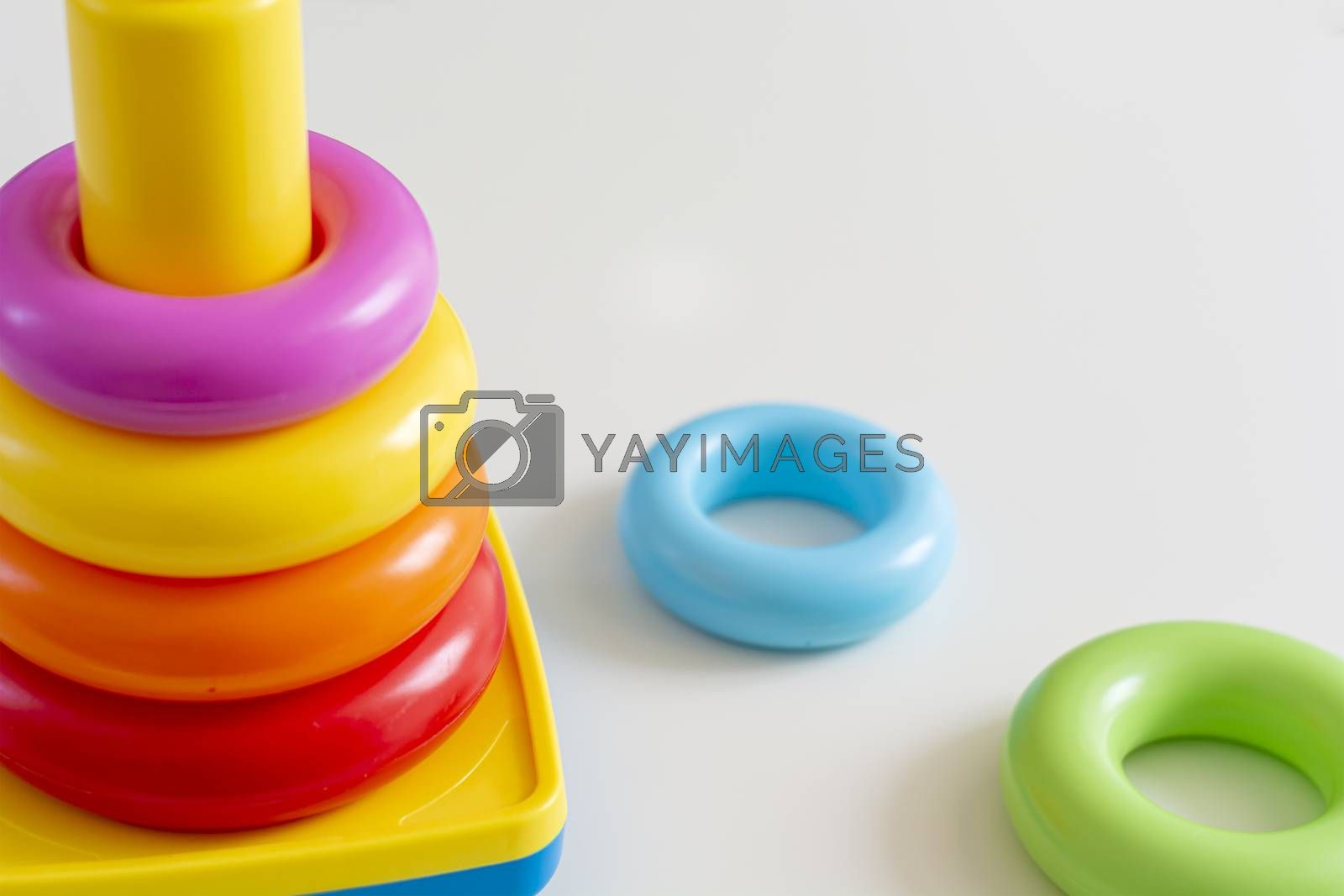 Colorful plastic rings stacked in a tower. Toy for newborns.