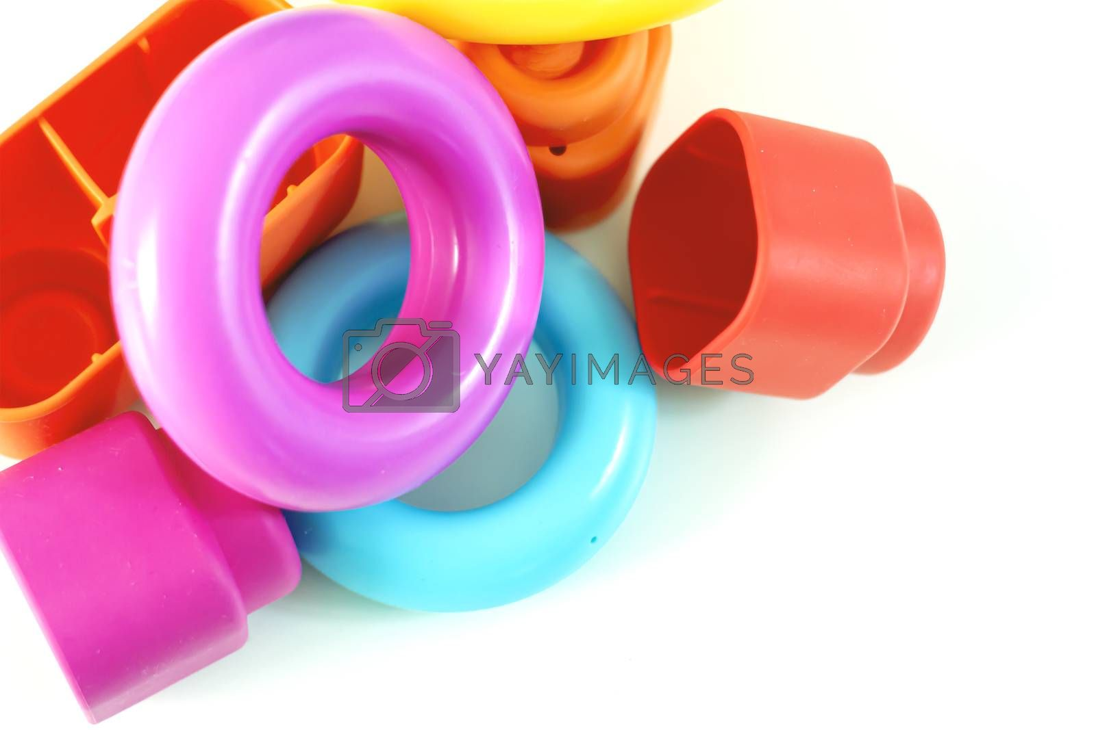 Colored plastic rings and rubber bricks for children to play. Children's toys. Growth and learning