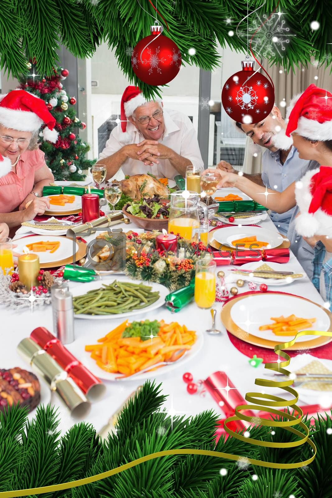 Happy family in santas hats enjoying christmas dinner by Wavebreakmedia