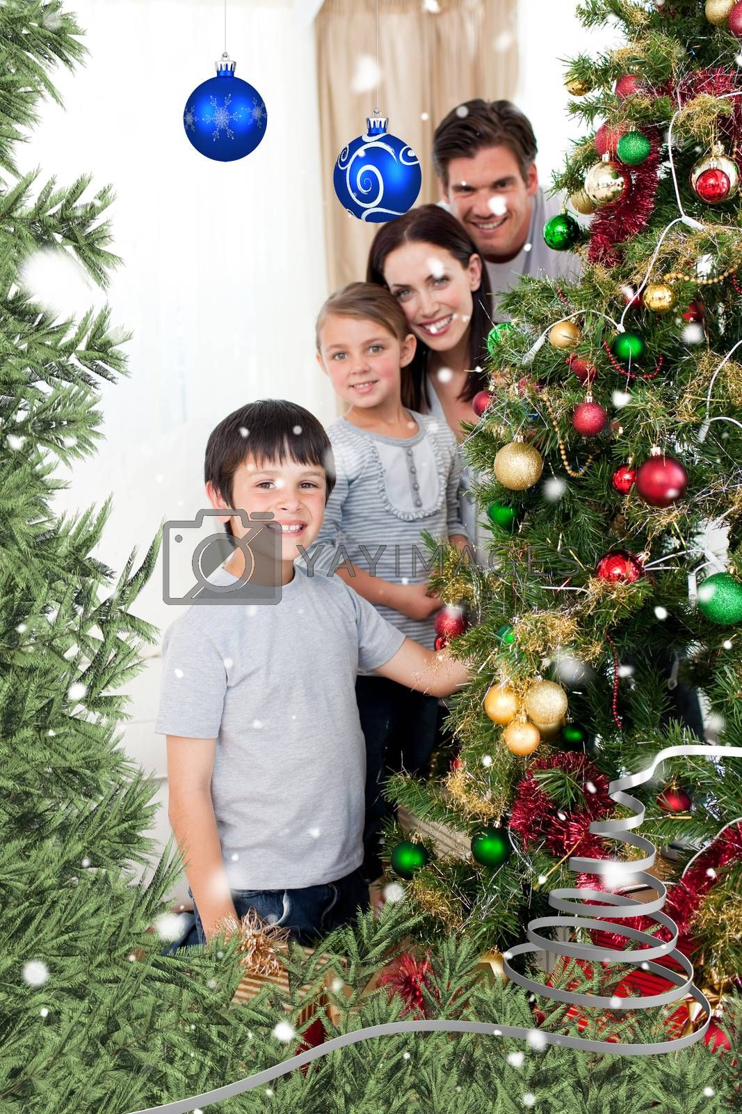 Composite image of happy family decorating a christmas tree with boubles and presents by Wavebreakmedia