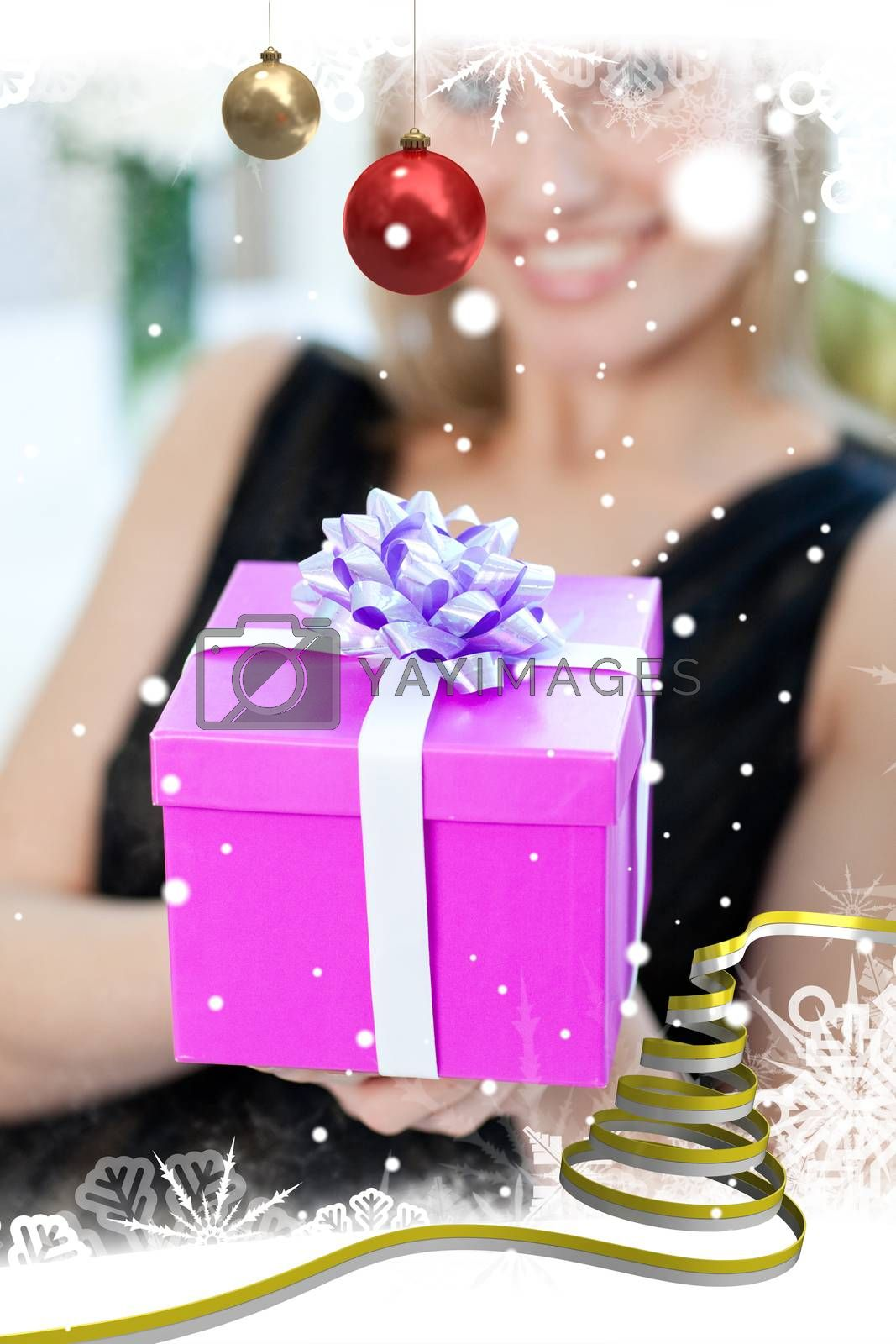 Blond woman opening a gift sitting on a sofa by Wavebreakmedia