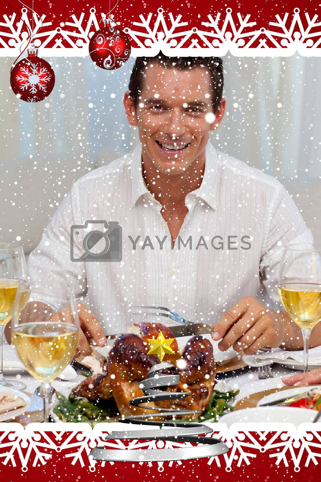 Smiling man eating turkey in Christmas dinner against snow falling