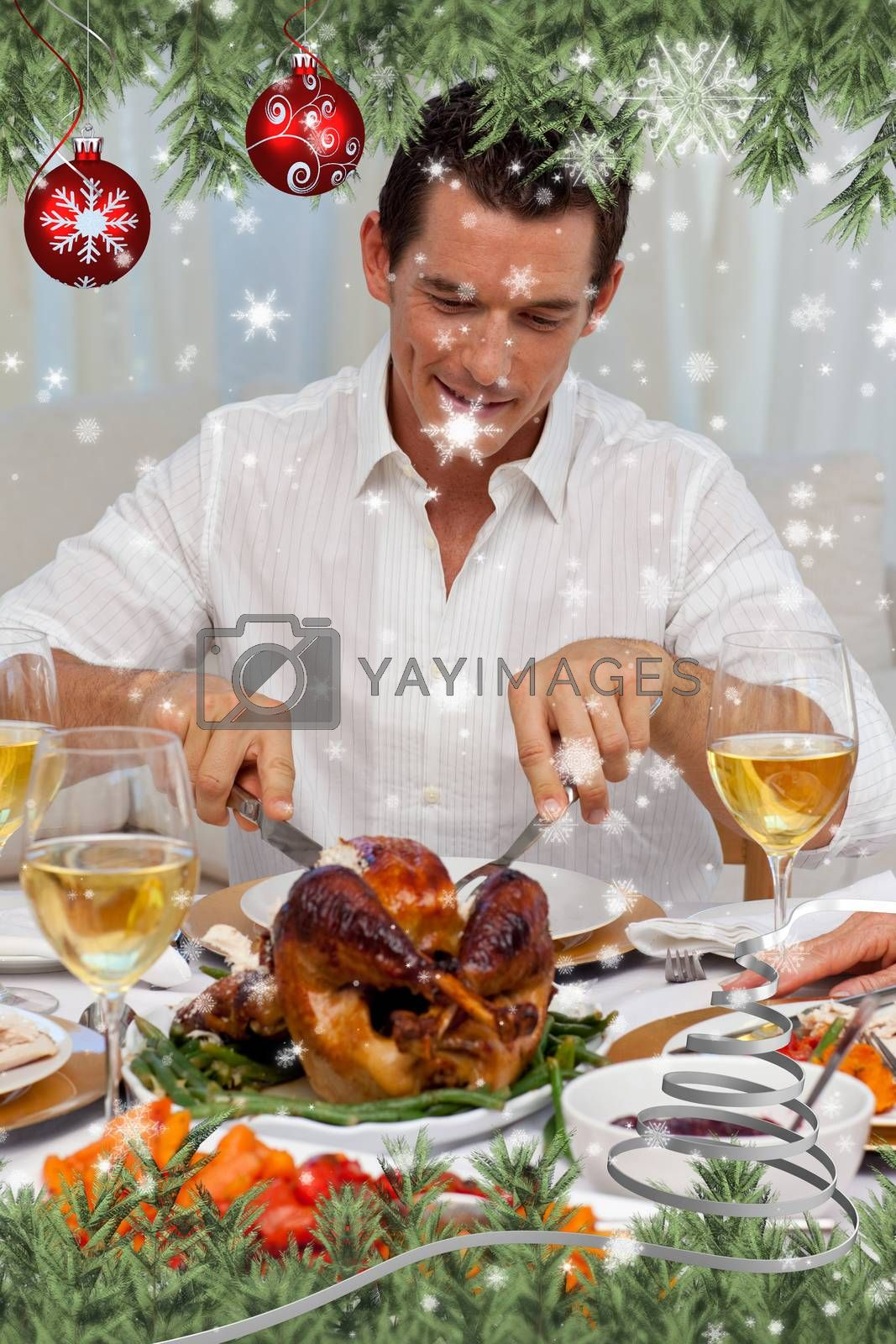 Attractive man eating turkey in Christmas dinner against snow falling