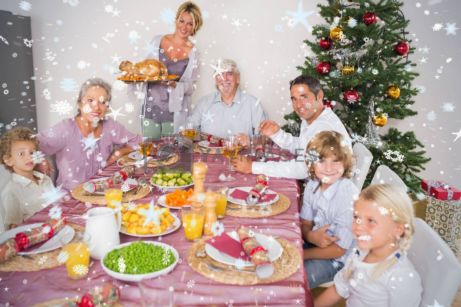 Composite image of Mother bringing turkey to dinner table against snow