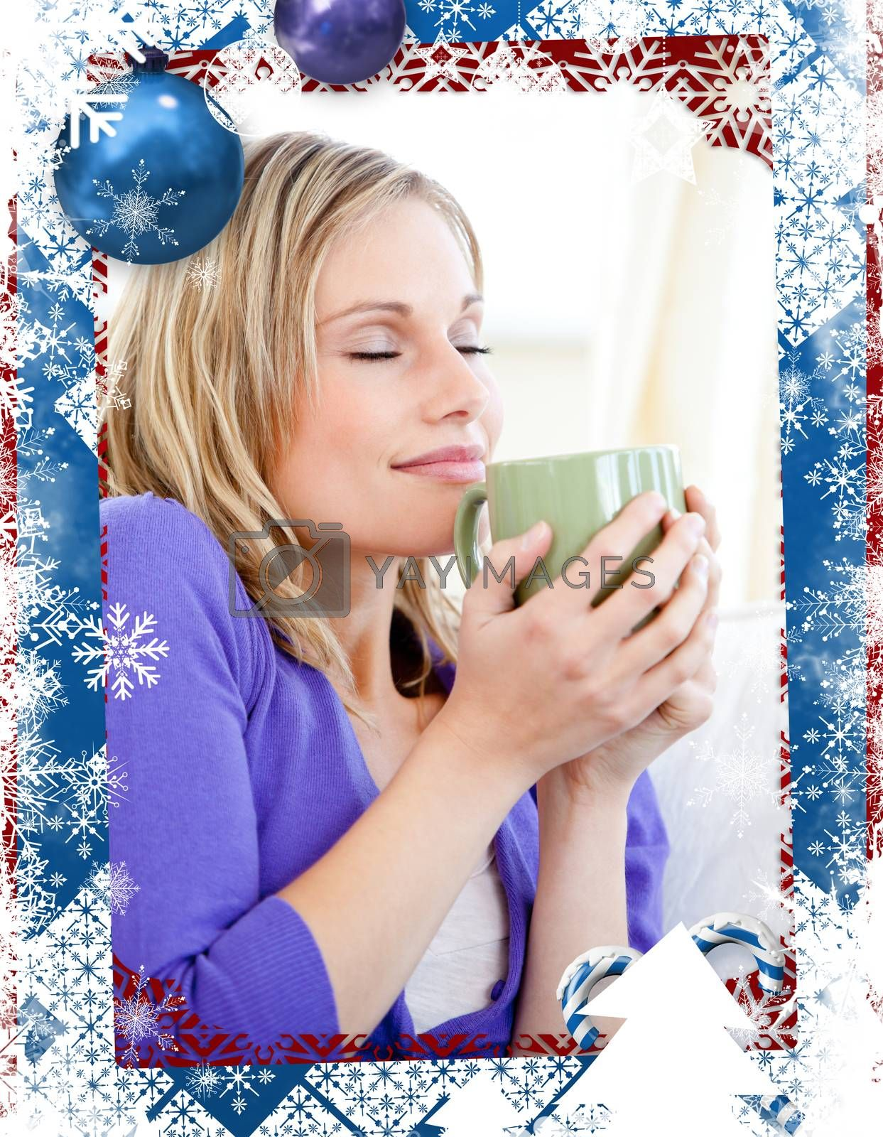 Glowing woman holding a cup of coffee against christmas themed frame