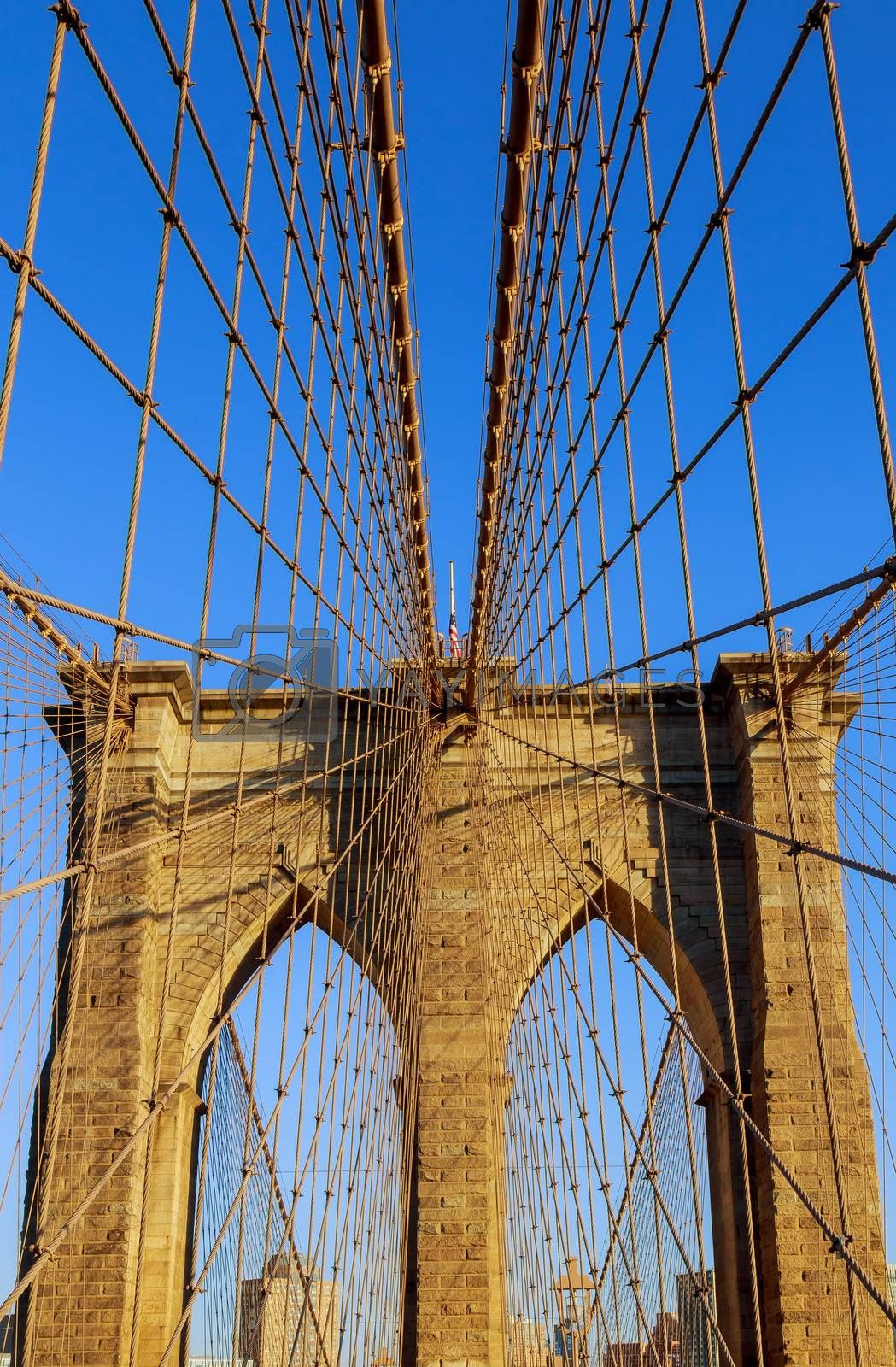 View of upward image of Brooklyn Bridge in New York from the East river