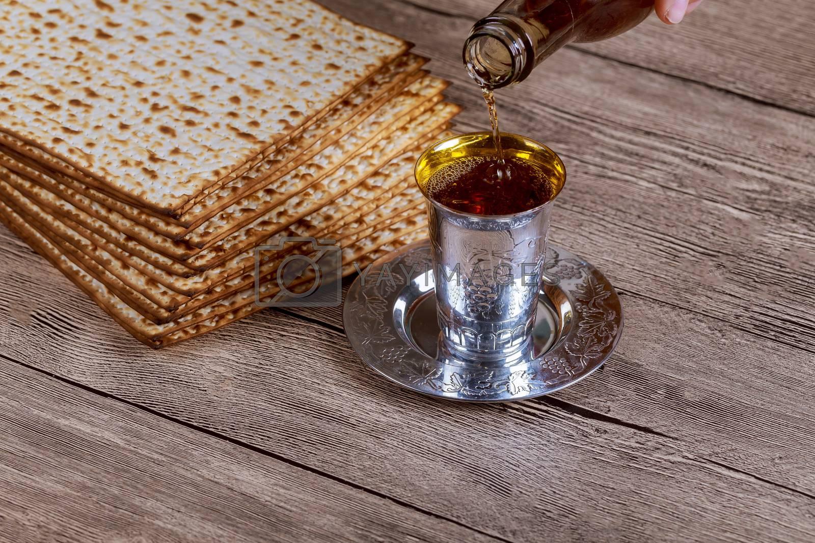 Jewish Pesah celebrating, matzoh and traditional kosher wine