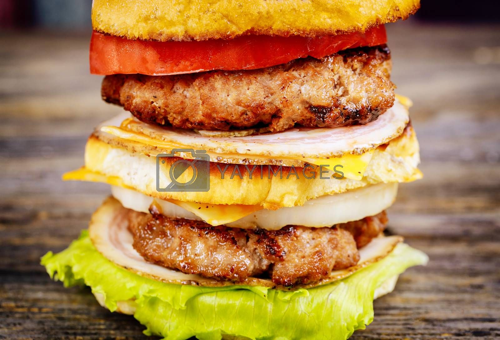 Beef burger, hamburger with grilled meat and vegetables
