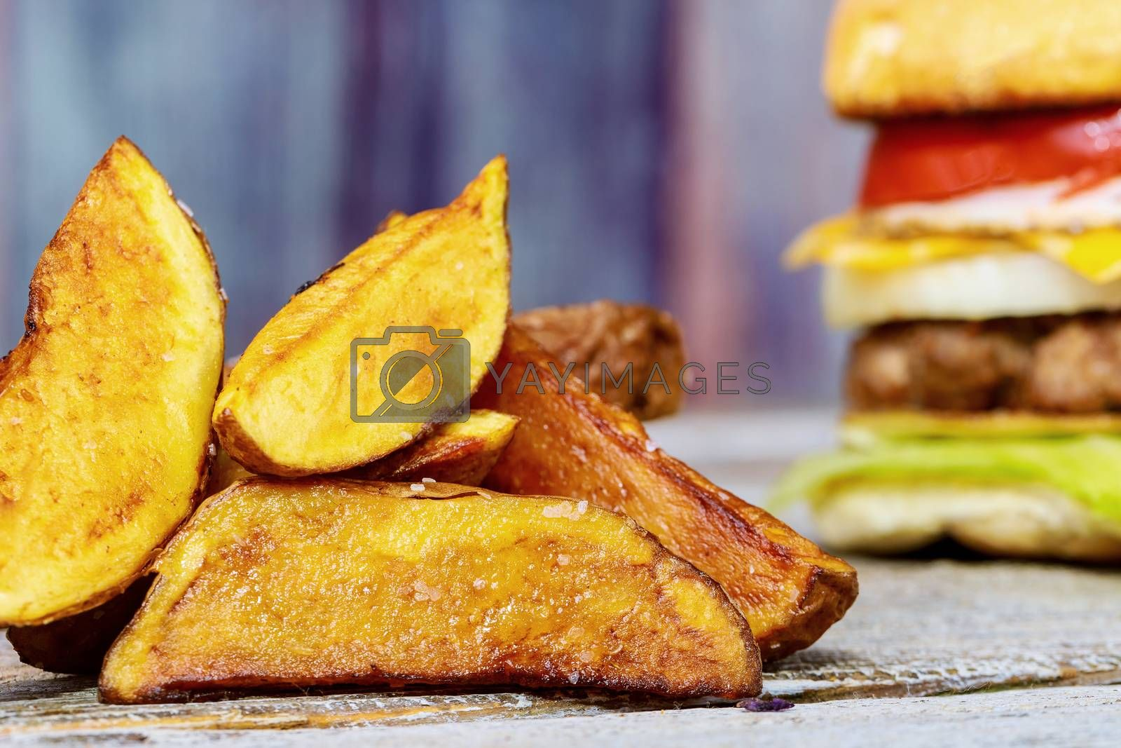 French fries with burger cutlet and cheese and tomato