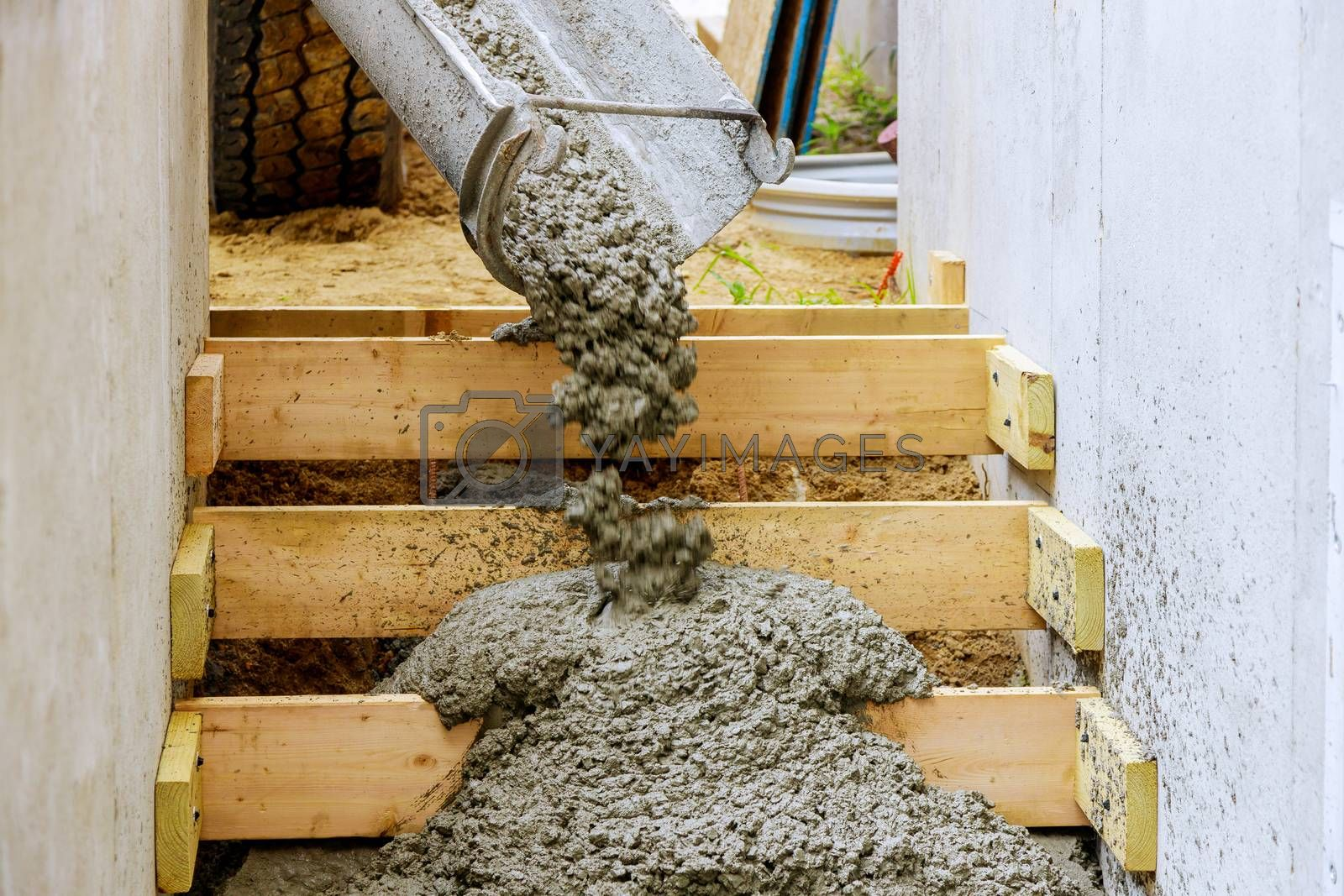 Pouring staircase in residential house building concreting steps with formwork