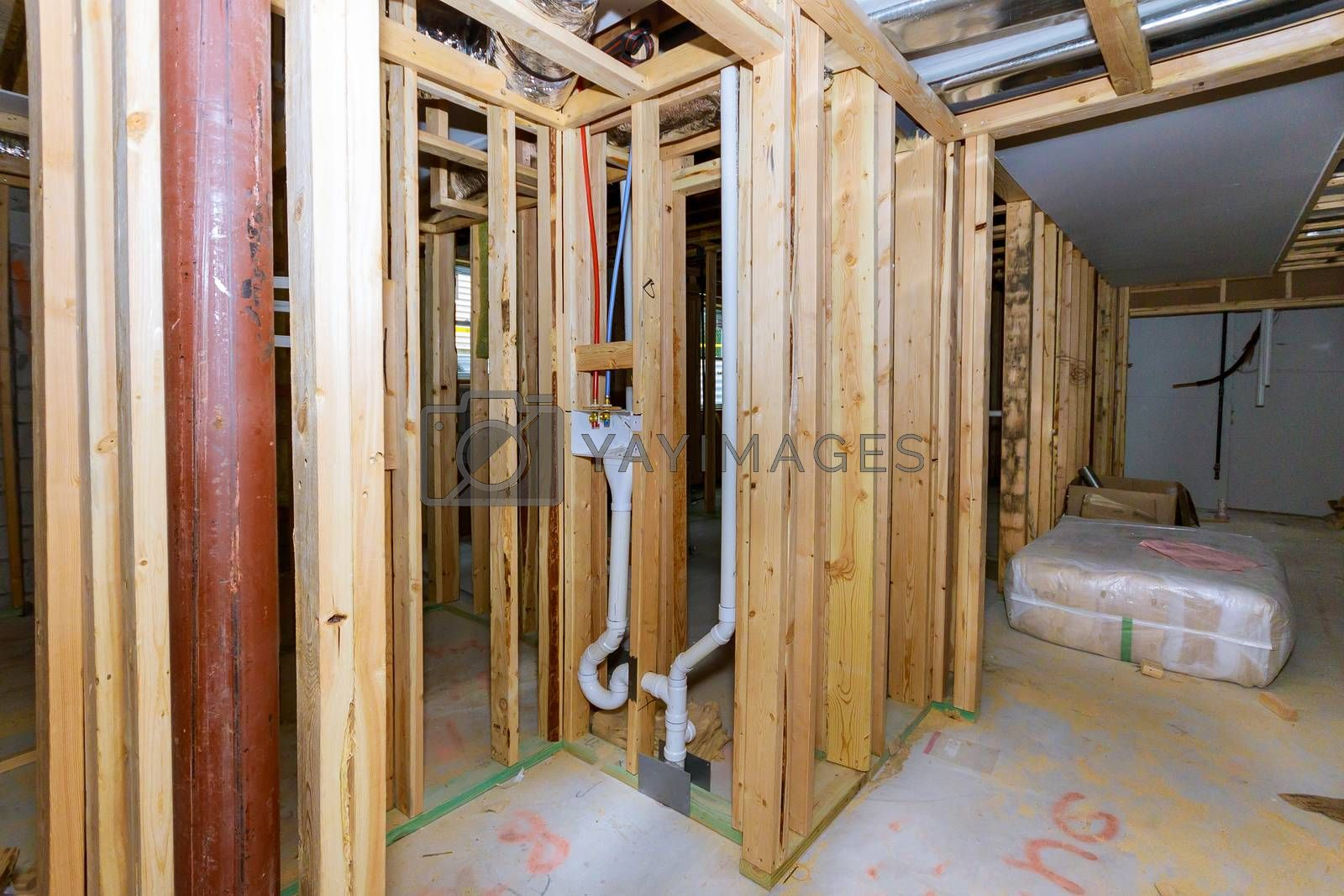 Home construction with plumbing for the laundry room unfinished basement interior stick built frame