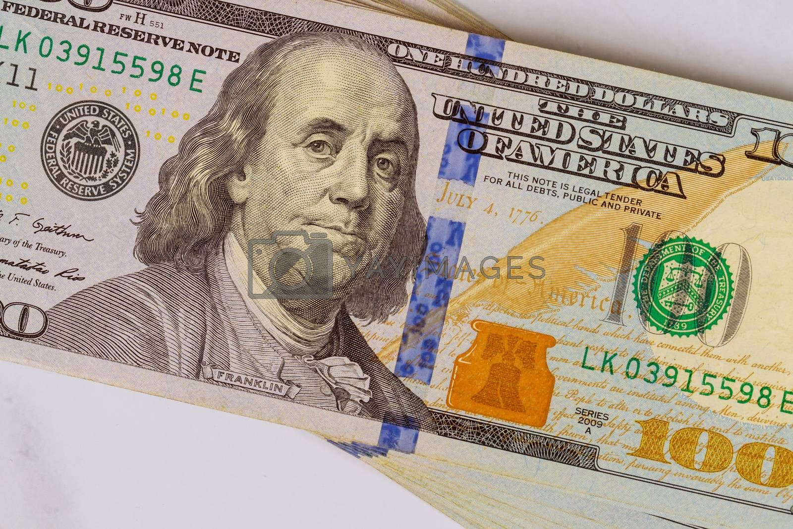 Dollars American bills in currency cash bundles on a white background